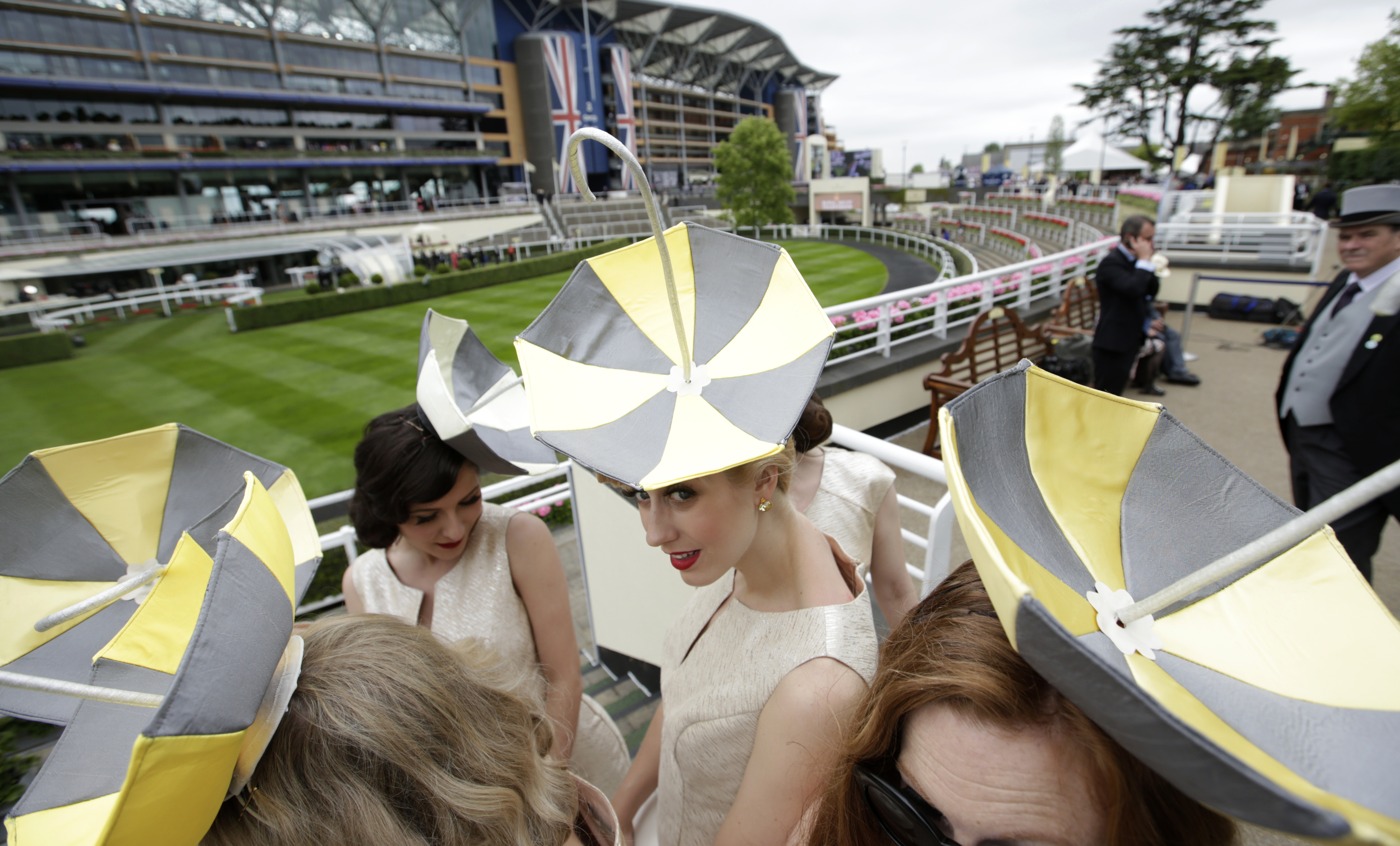 Umbrella hats worn by a singing group as they pose next to the parade ring on the second day of  Royal Ascot horse racing meet at Ascot, England, Wednesday, June 17, 2015. Royal Ascot is the annual five day horse race meeting that Britain's Queen Elizabet