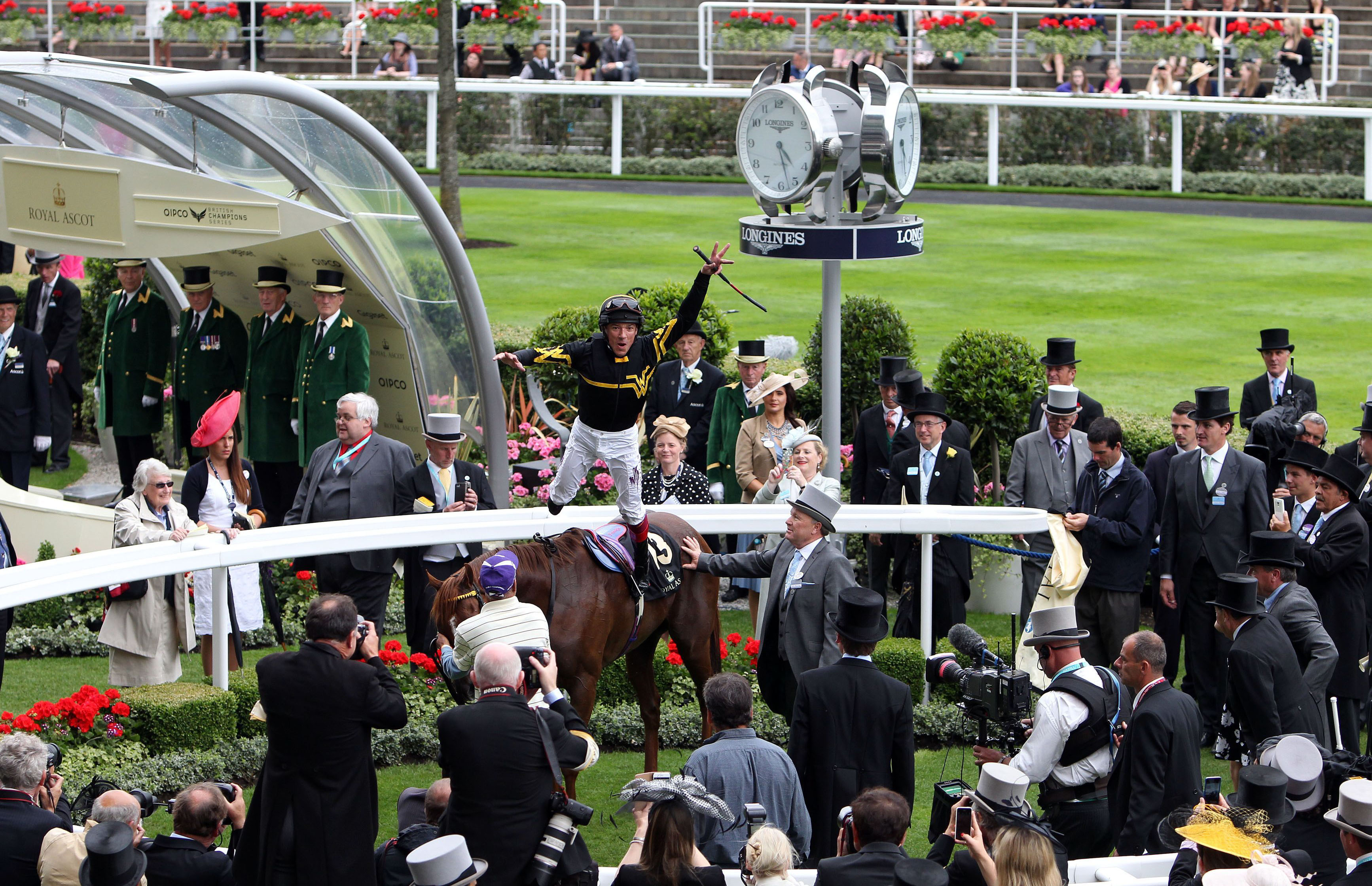 Jockey Frankie Dettori does his flying dismount, after winning the Diamond Jubilee Stakes with Undrafted, during day five of the 2015 Royal Ascot Meeting, at Ascot Racecourse, in Berkshire, England,  Saturday June 20, 2015. (Steve Parsons/PA, via AP) UNIT