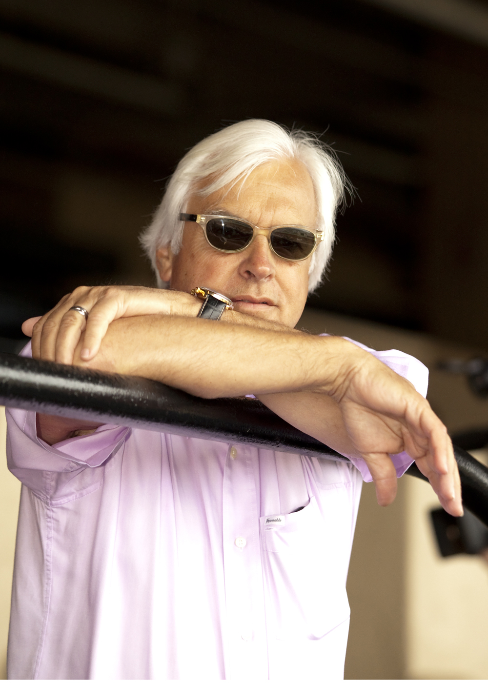 In this photo provided by Benoit Photo, trainer Bob Baffert watches as Triple Crown winner American Pharoah works Tuesday morning, July 28, 2015,  at Del Mar Race Track in Del Mar, Calif.  (Benoit Photo via AP)