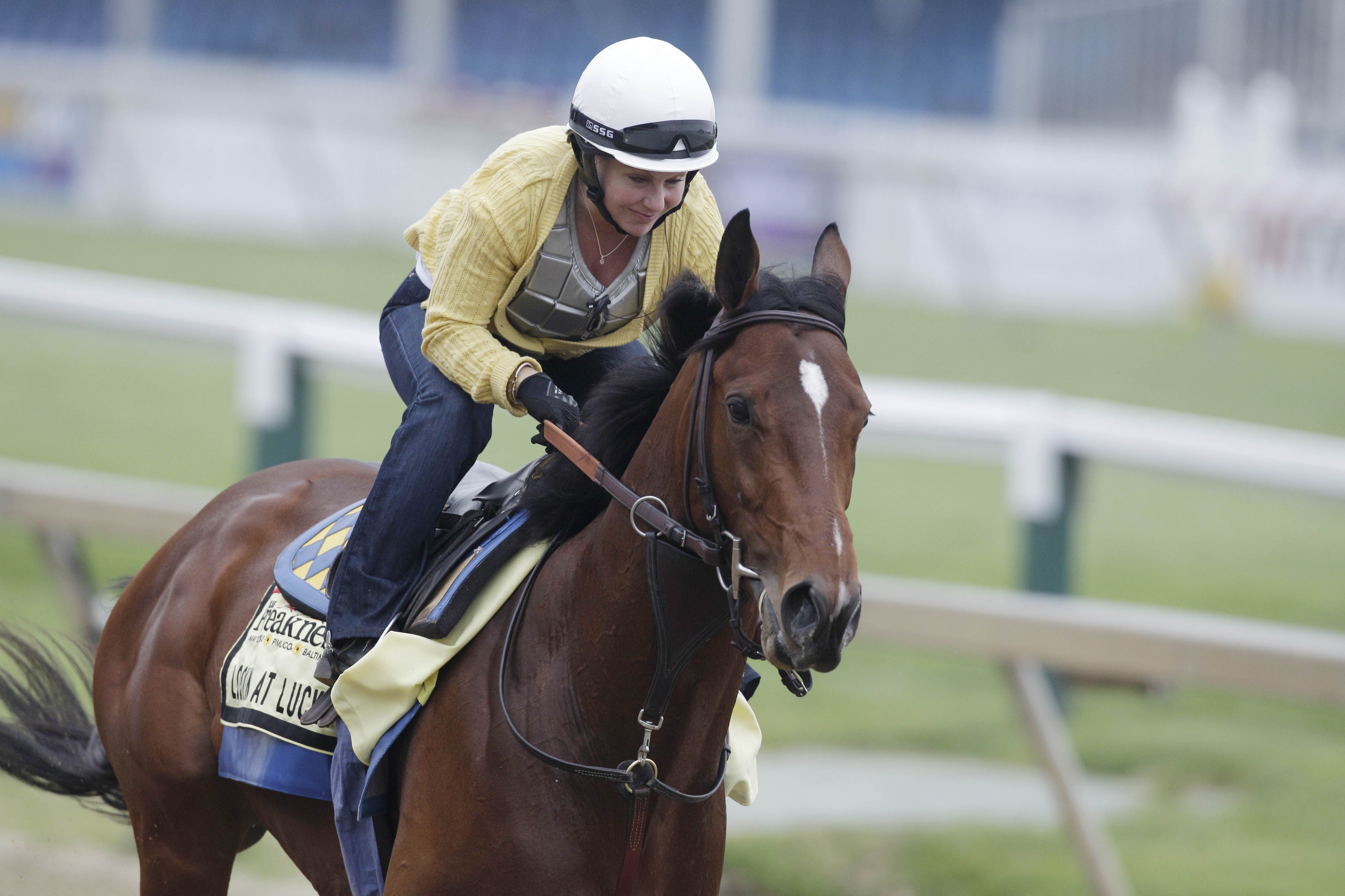 FILE - In this May 14, 2010 file photo, Preakness entrant Lookin At Lucky with Dana Barnes aboard gallops during morning workouts at Pimlico Race Course, in Baltimore.   Even with Derby winner Super Saver in the field, it was Bob Baffert's Preakness winne