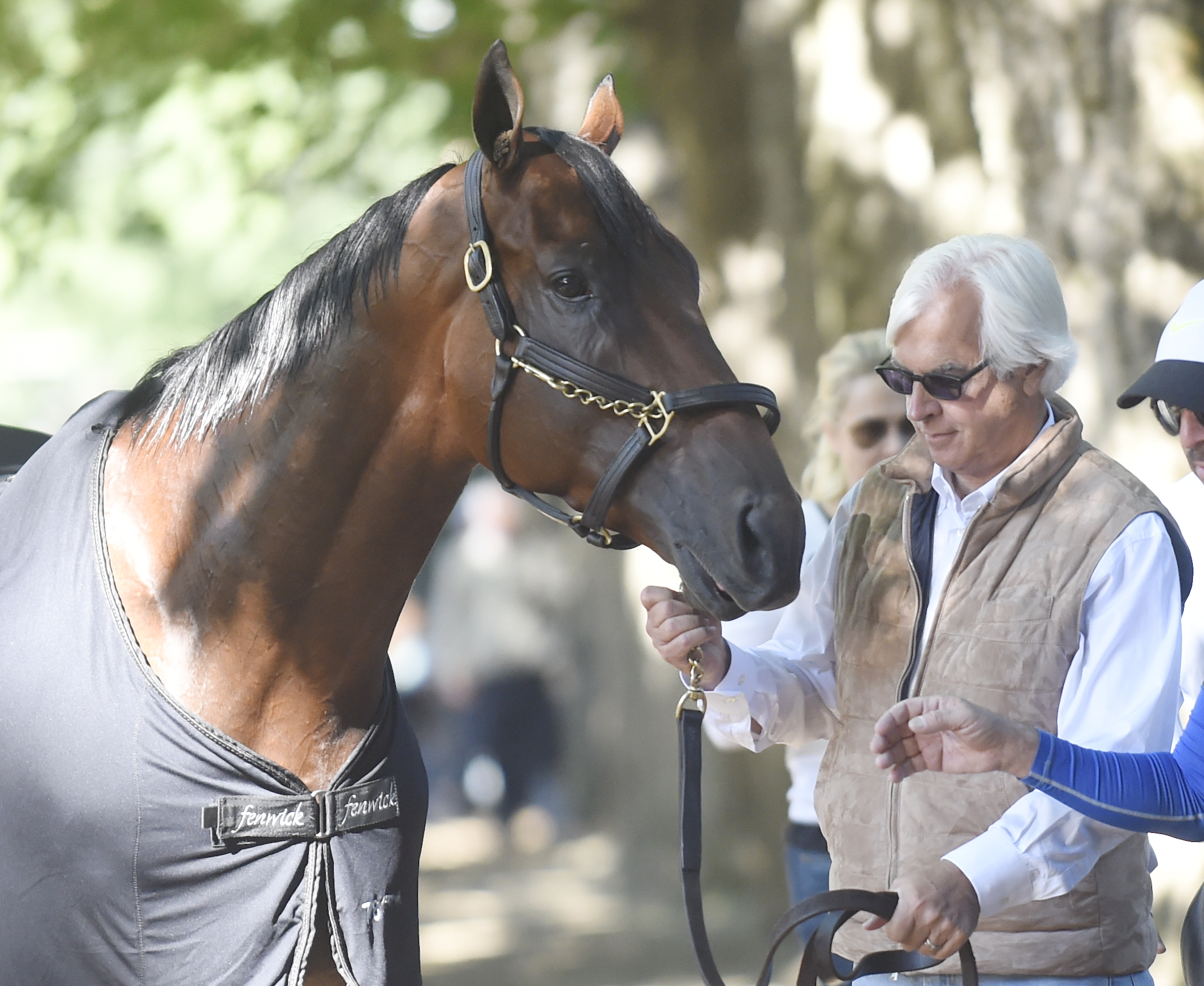 Trainer Bob Baffert holds Triple Crown winner American Pharoah after a workout at Saratoga Race Course on Friday, Aug. 28, 2015, in Saratoga Springs, N.Y. American Pharoah is the overwhelming 1-5 favorite in a 10-horse field for Saturday's Travers Stakes
