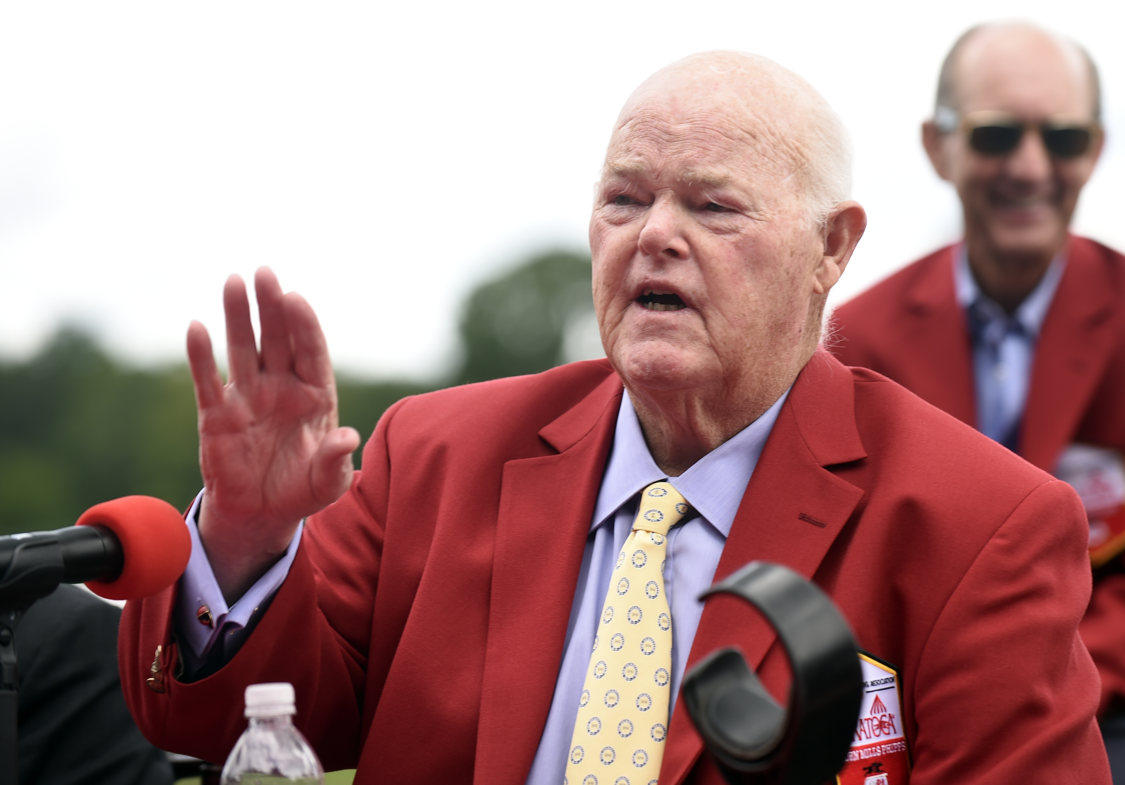"Ogden Mills ""Dinny"" Phipps of Phipps Stable talks to reporters after being inducted to the New York Racing Association 2015 Saratoga Walk of Fame during the annual Red Jacket Ceremony at Saratoga Race Course on Friday, August 28, 2015 in Saratoga Springs,"