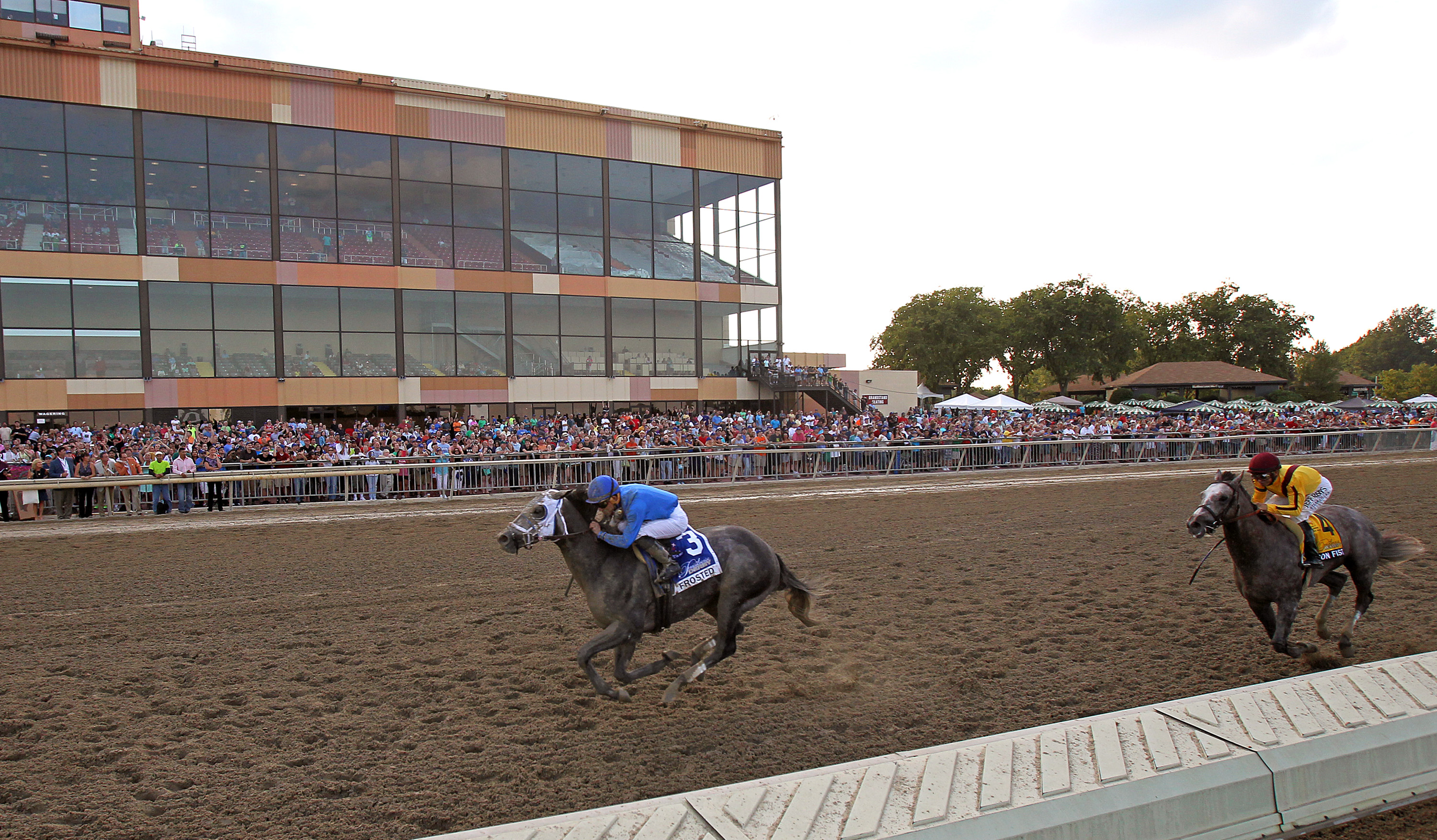 In a photo provided by Equi=Photo, Frosted, left, with Joel Rosario riding, wins the $1 million Pennsylvania Derby horse race at Parx Racing in Bensalem, Pa., on Saturday, Sept, 19, 2015. Iron Fist, right, with Mike Smith, was second. (Bill Denver/Equi-Ph
