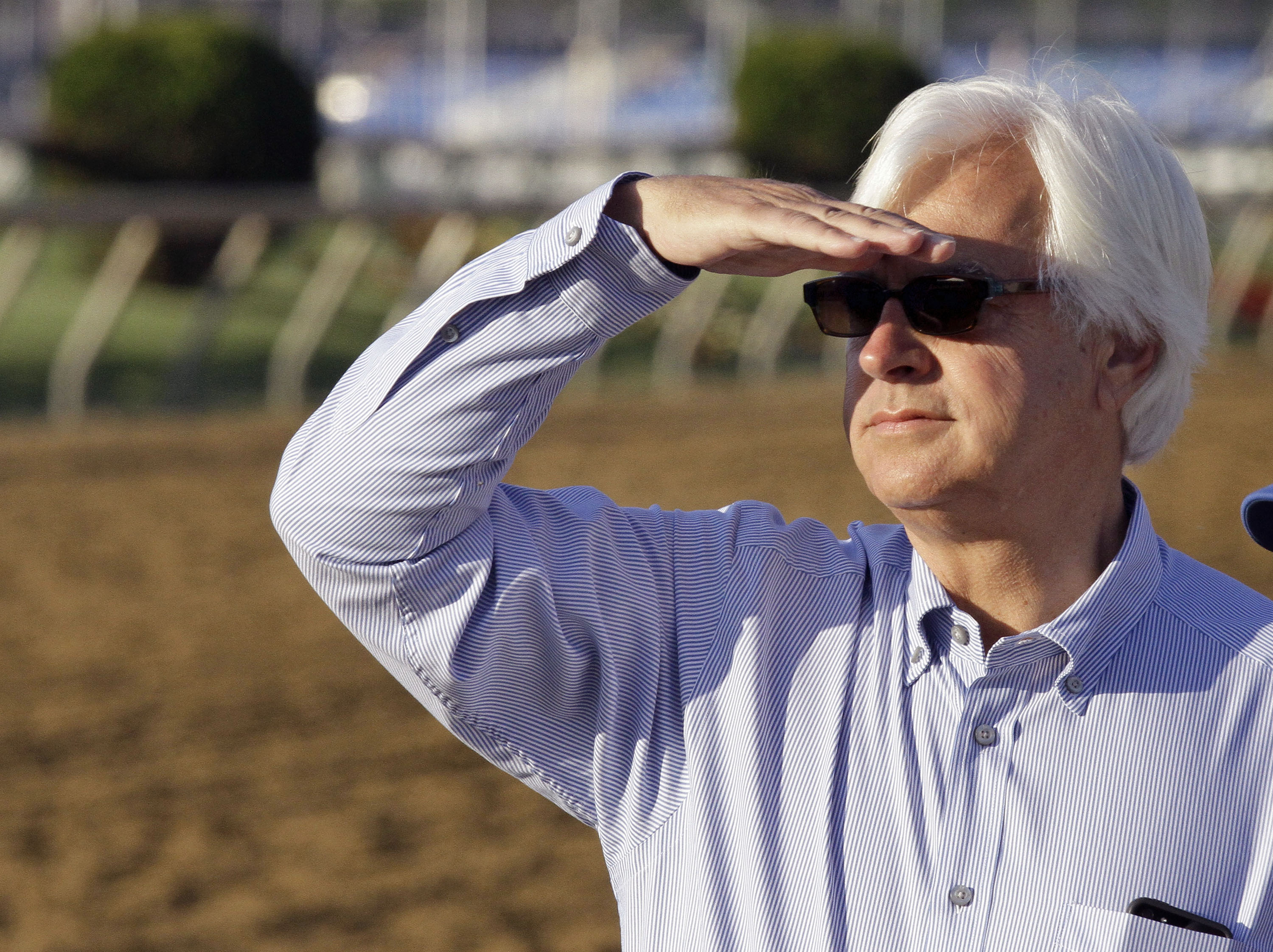 FILE - In this May 17, 2013, file photo, Hall of Fame trainer Bob Baffert watches a morning workout at Pimlico Race Course in Baltimore. Bob Baffert is ahead of the pack again, leading all trainers with 35 horses nominated to the Triple Crown races. The t