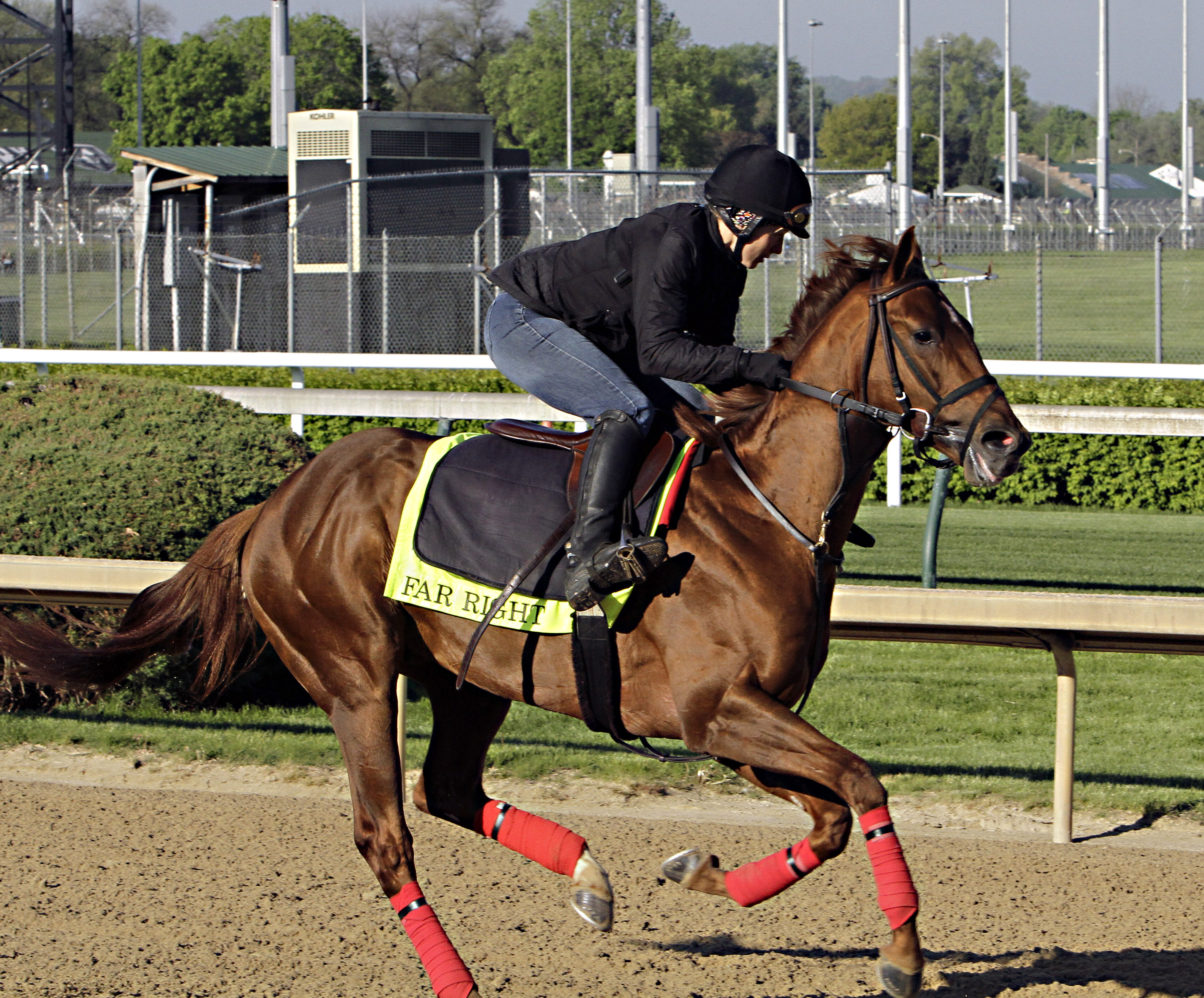 FILE - In this April 28, 2015, file photo, exercise rider Laura Moquett gallops Kentucky Derby hopeful Far Right at Churchill Downs in Louisville, Ky. Training Ron Moquett wasn't born into the horse racing business, but he's risen through the ranks to bec