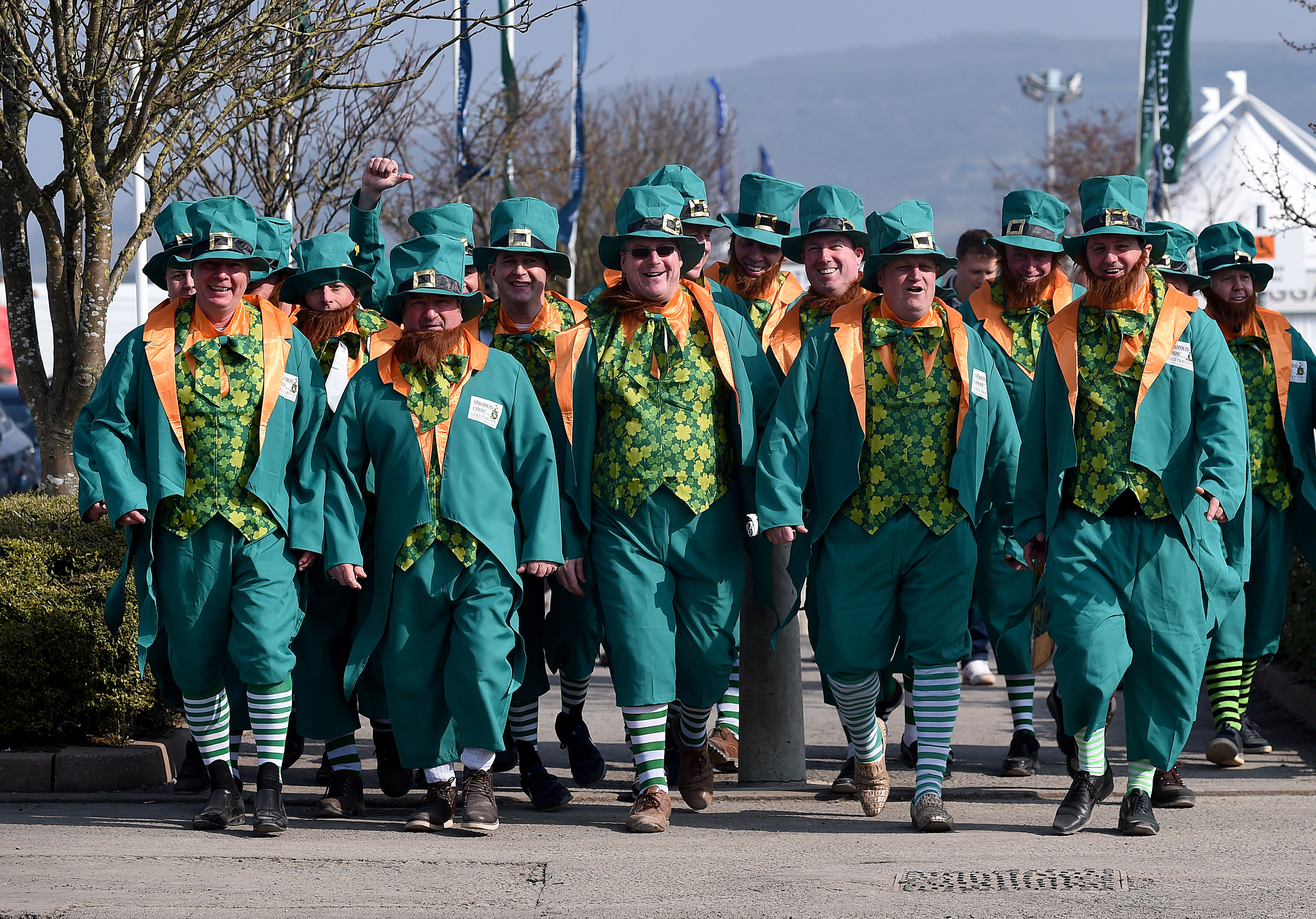 Racegoers dressed in fancy dress arrive  at Cheltenham Racecourse in Cheltenham England on St Patrick's Thursday March 17, 2016.  Cheltenham always attracts a large number Irish people to the Cheltenham Horse Racing Festival.(Joe Giddens/PA via AP) UNITED
