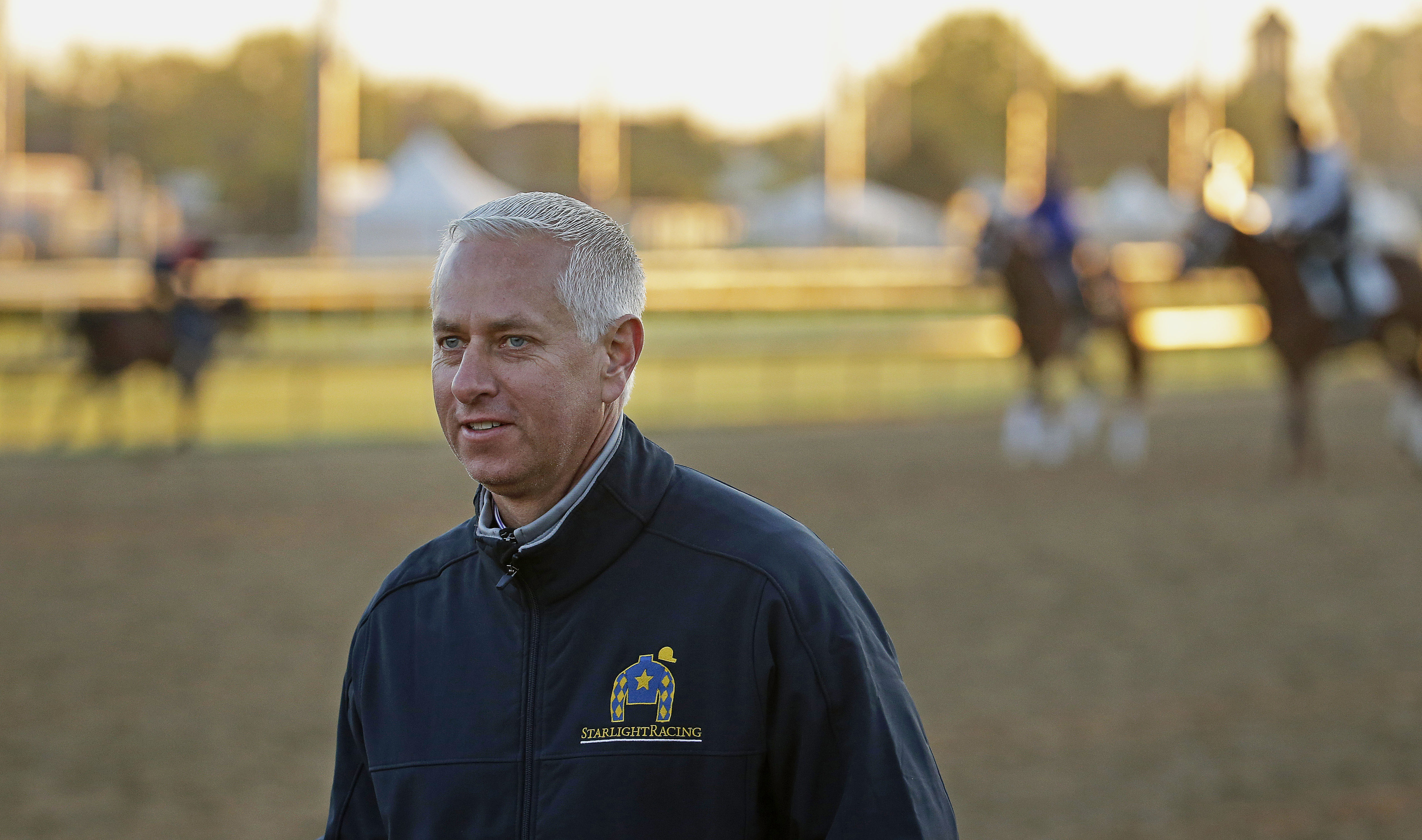 FILE - In this April 29, 2015, file photo, trainer Todd Pletcher watches horses on the track at Churchill Downs in Louisville, Ky. Pletcher became the 10th thoroughbred trainer to reach 4,000 victories when Eagle Scout won the fifth race at Gulfstream Par
