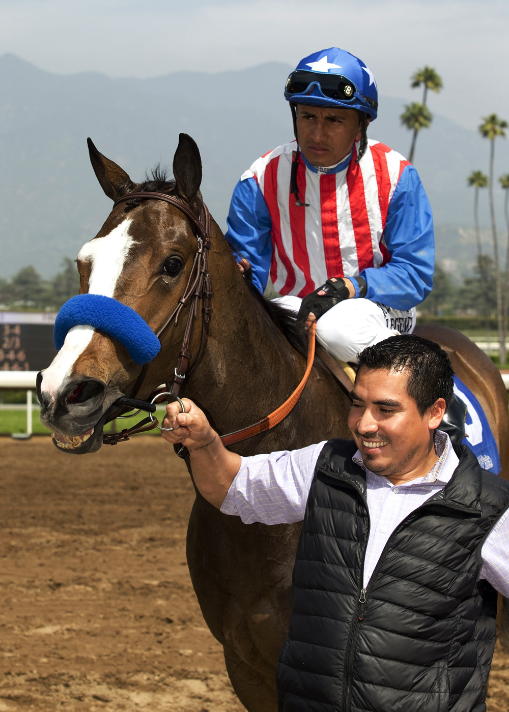 In this image provided by Benoit Photo, Kaleem Shah's Fantastic Style and jockey Rafael Bejarano are guided into the winner's circle after their victory in the Las Flores Stakes at Santa Anita Park in Arcadia, Calif., Sunday, March 20, 2016. They won the