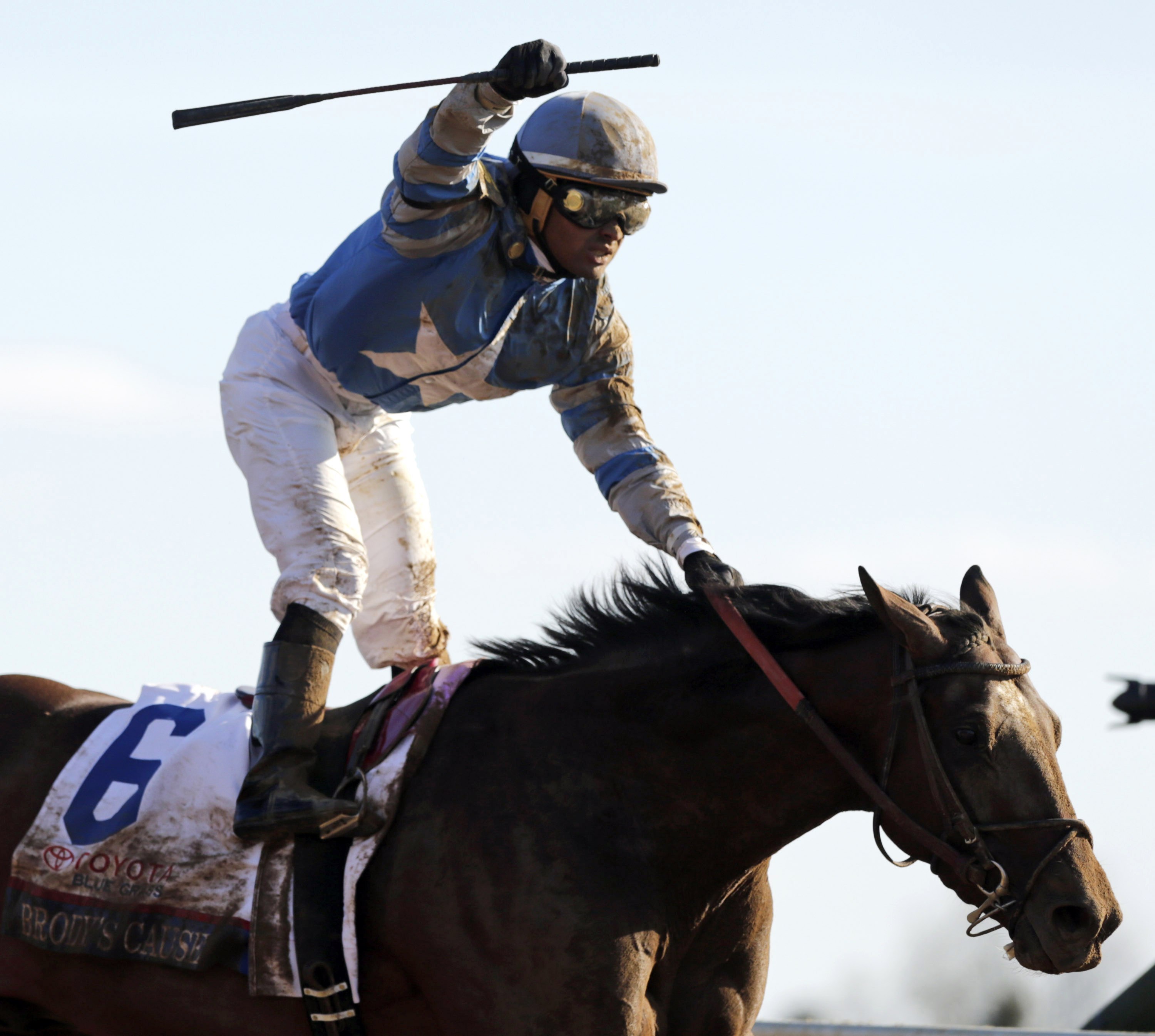 Jockey Luis Saez pumps his fist after riding Brody's Cause to win the Blue Grass Stakes horse race at Keeneland Race Course, Saturday, April 9, 2016, in Lexington, Ky (Pablo Alcala/Lexington Herald-Leader via AP) MANDATORY CREDIT