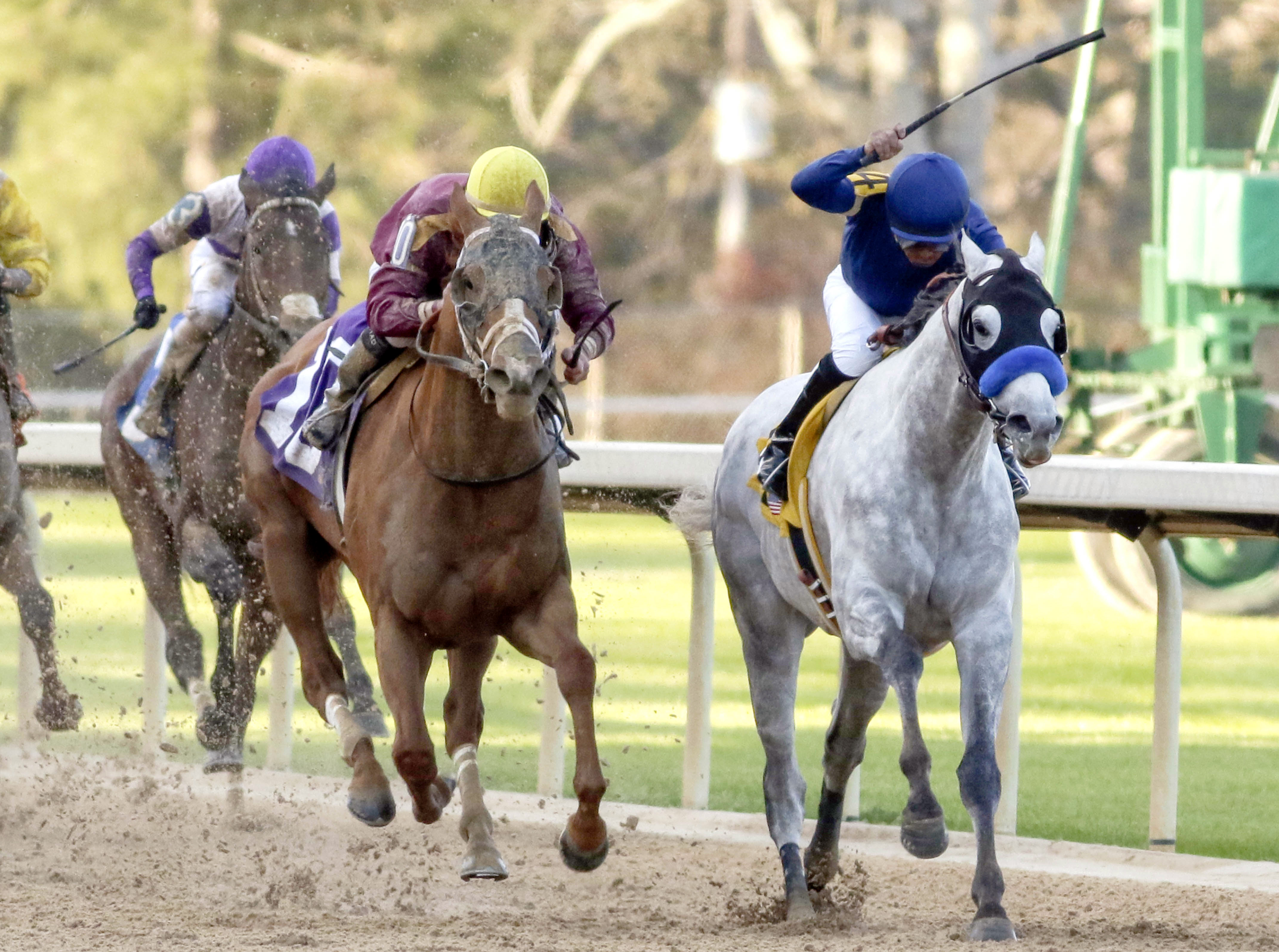 FILE - In this March 19, 2016, file photo, Cupid and jockey Martin Garcia, right, battles Whitmore and jockey Irad Ortiz, Jr., center, down the stretch to win the Rebel Stakes horse race at Oaklawn Park in Hot Springs, Ark. Win or lose the Arkansas Derby,