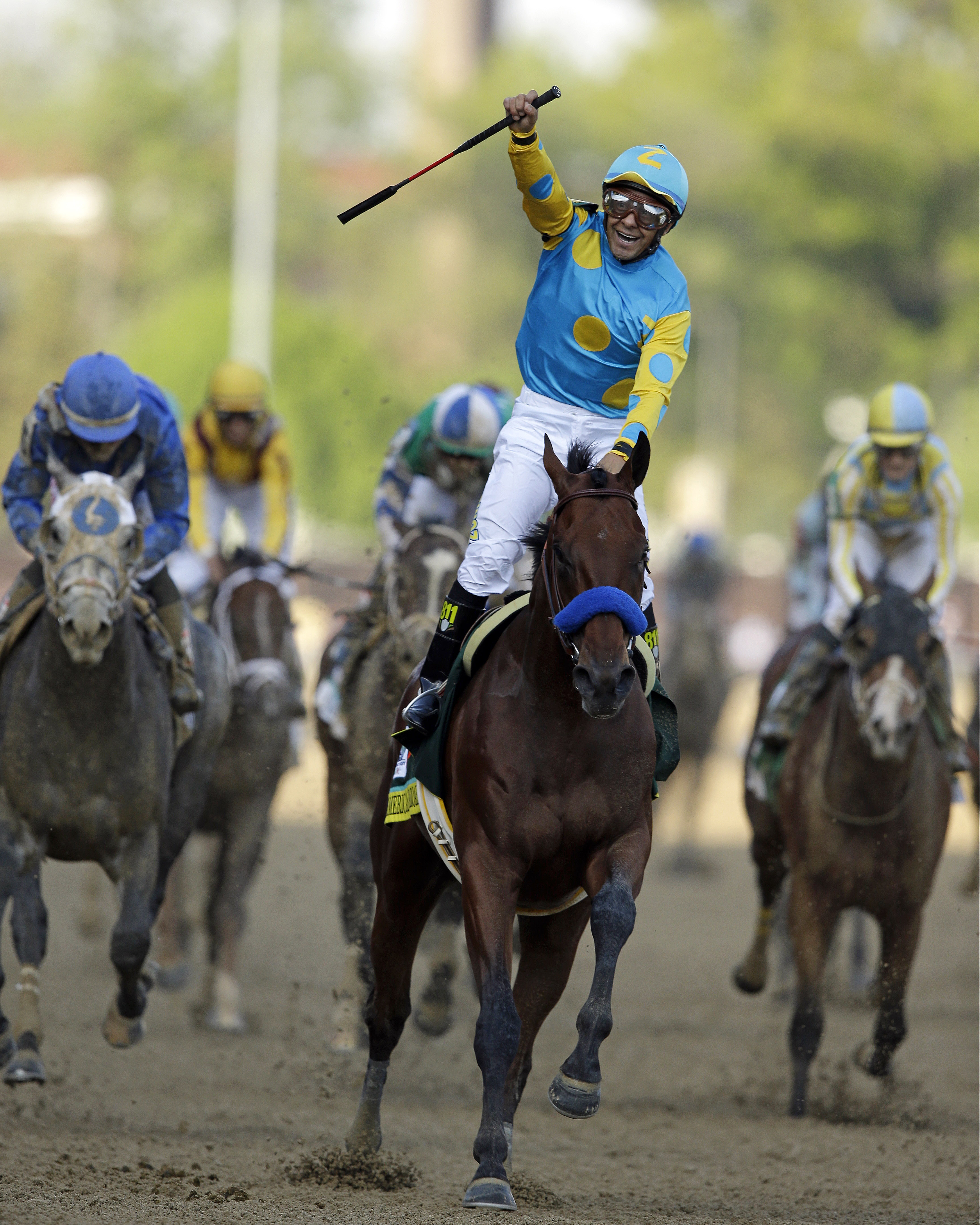 FILE - In this May 2, 2015 file photo, Victor Espinoza rides American Pharoah to victory in the 141st running of the Kentucky Derby horse race at Churchill Downs, in Louisville, Ky. Victor Espinoza will have a chance for an unprecedented three-peat in the