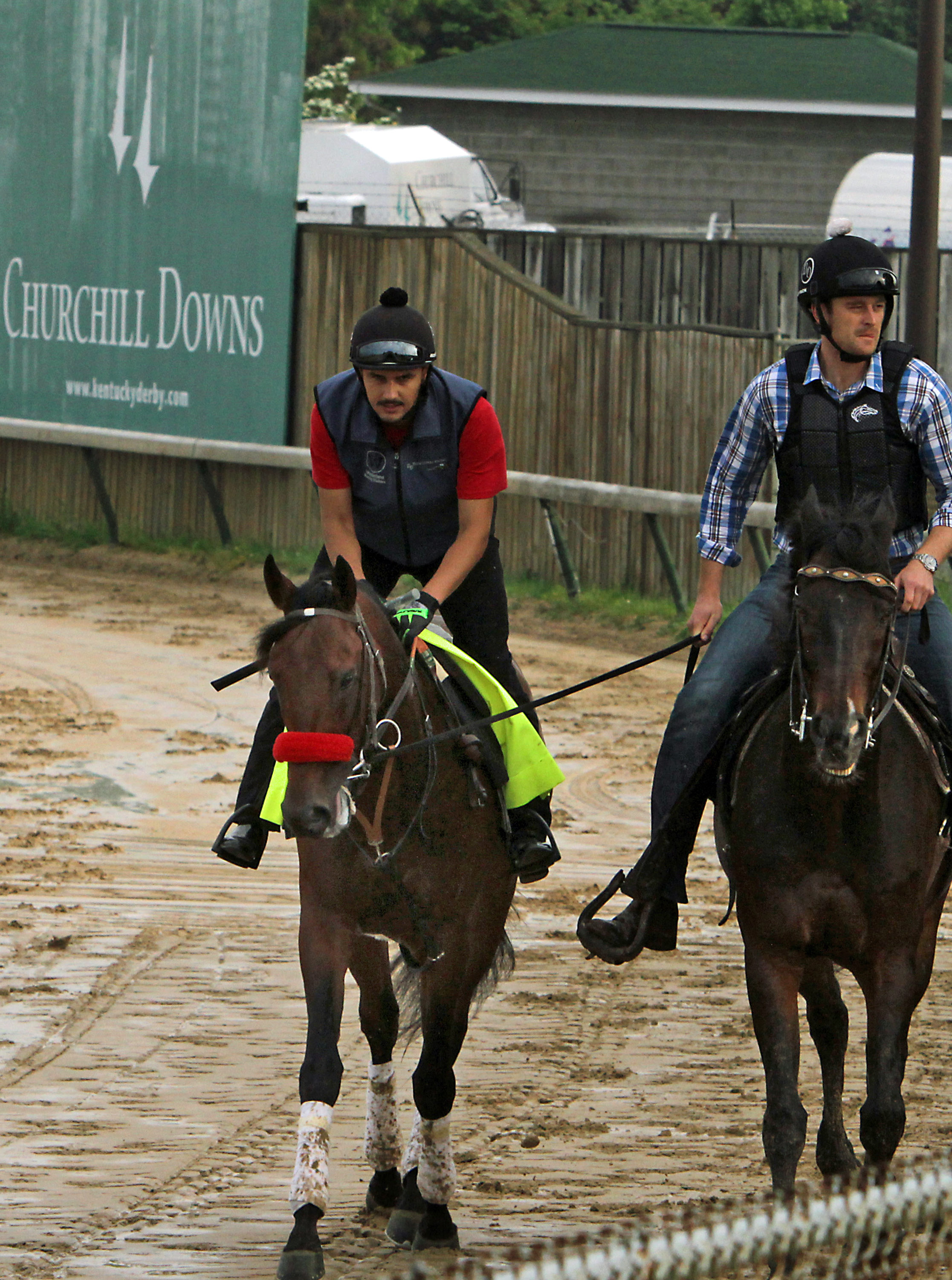 Kentucky Derby hopeful Nyquist, with exercise rider Jonny Garcia in the saddle, walks the wrong way on the track at Churchill Downs in Louisville, Ky., Sunday, May 1, 2016. It was the colt's first trip to the racing surface since shipping from Keeneland.