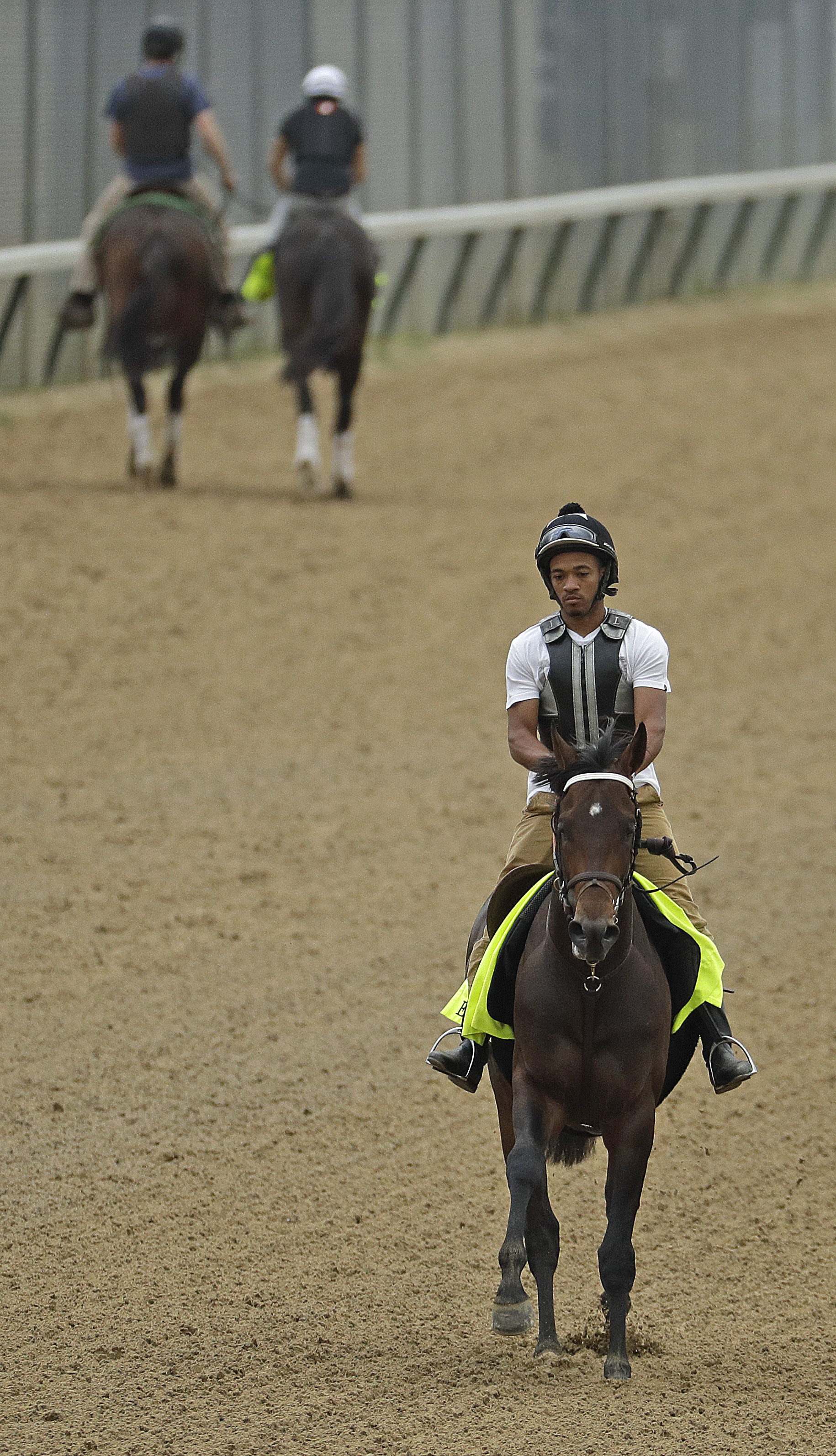 Exercise rider Peedy Landry rides Kentucky Derby hopeful Exaggerator during a workout at Churchill Downs Tuesday, May 3, 2016, in Louisville, Ky. The 142nd running of the Kentucky Derby is scheduled for Saturday, May 7. (AP Photo/Charlie Riedel)
