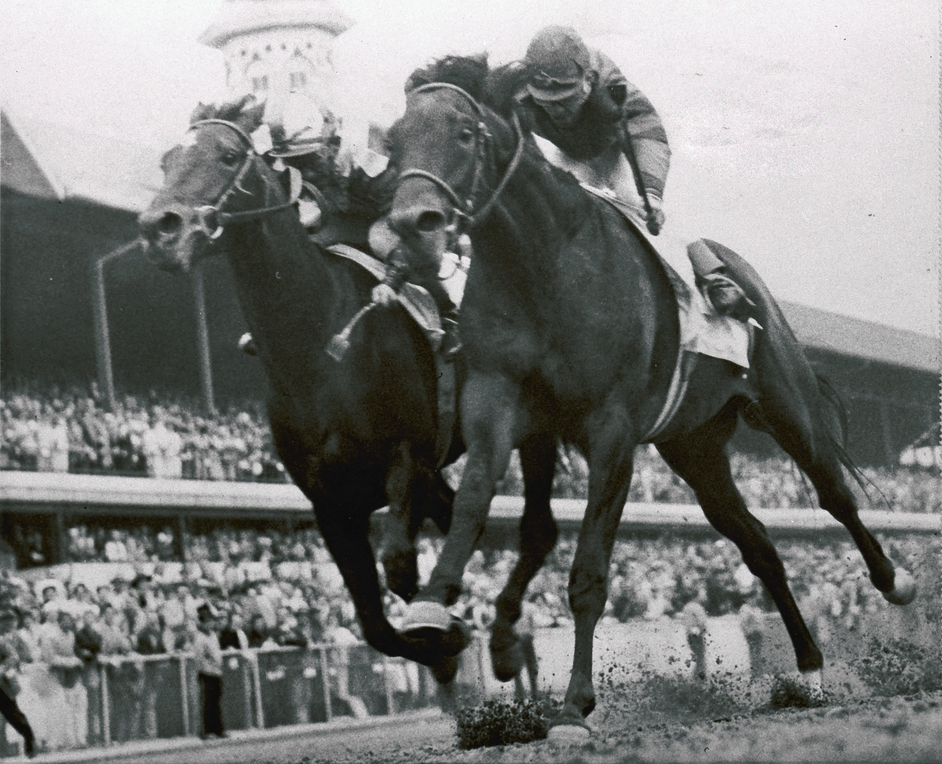 FILE - In this May 4, 1957 file photo,  Iron Liege, right, edges out Gallant Man at the finish line to win the Kentucky Derby horse race at Churchill Downs in Louisville, Ky. (AP Photo/File)