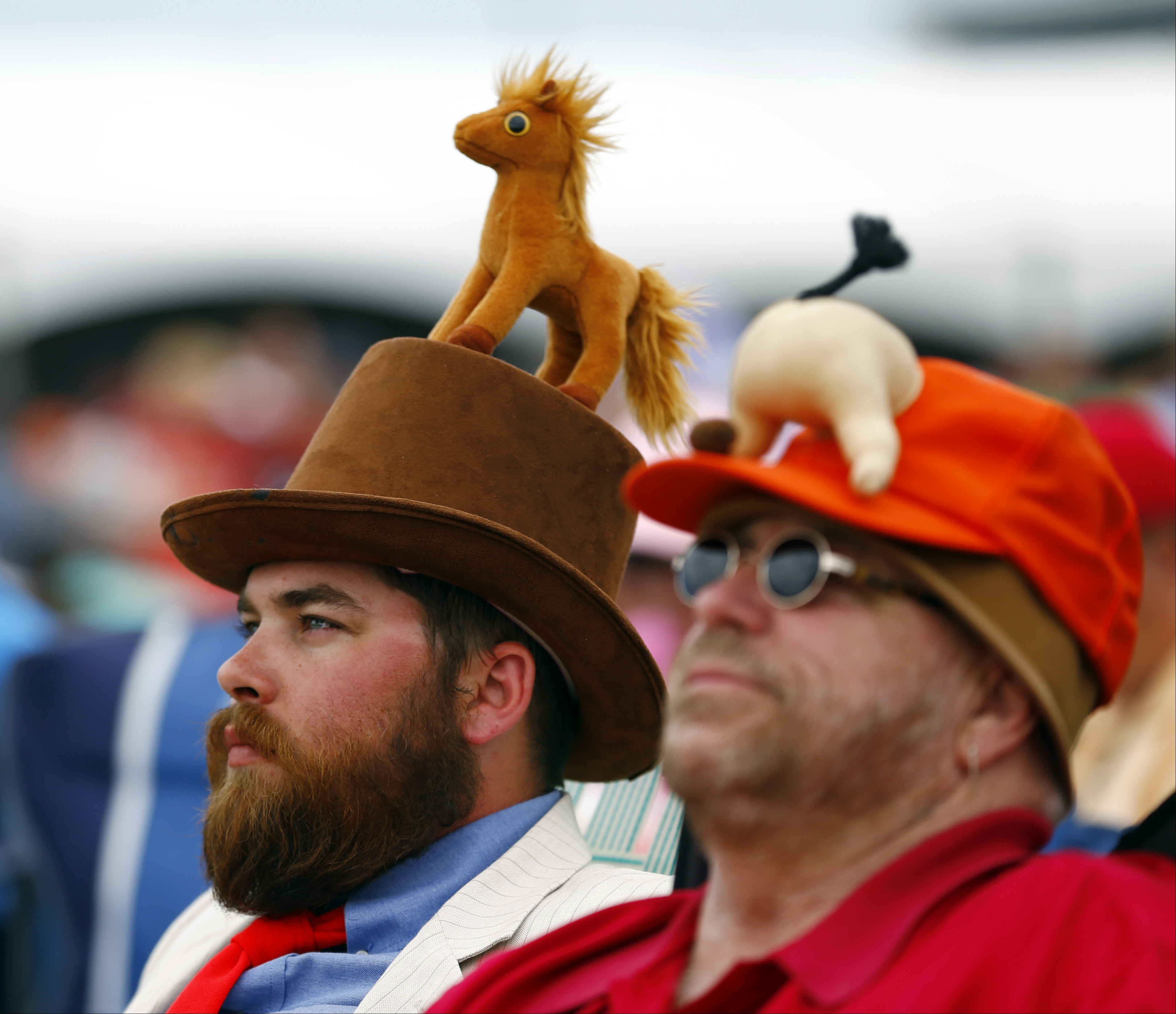 Fans wait for the start of the 142nd running of the Kentucky Derby horse race at Churchill Downs Saturday, May 7, 2016, in Louisville, Ky. (AP Photo/Julio Cortez)