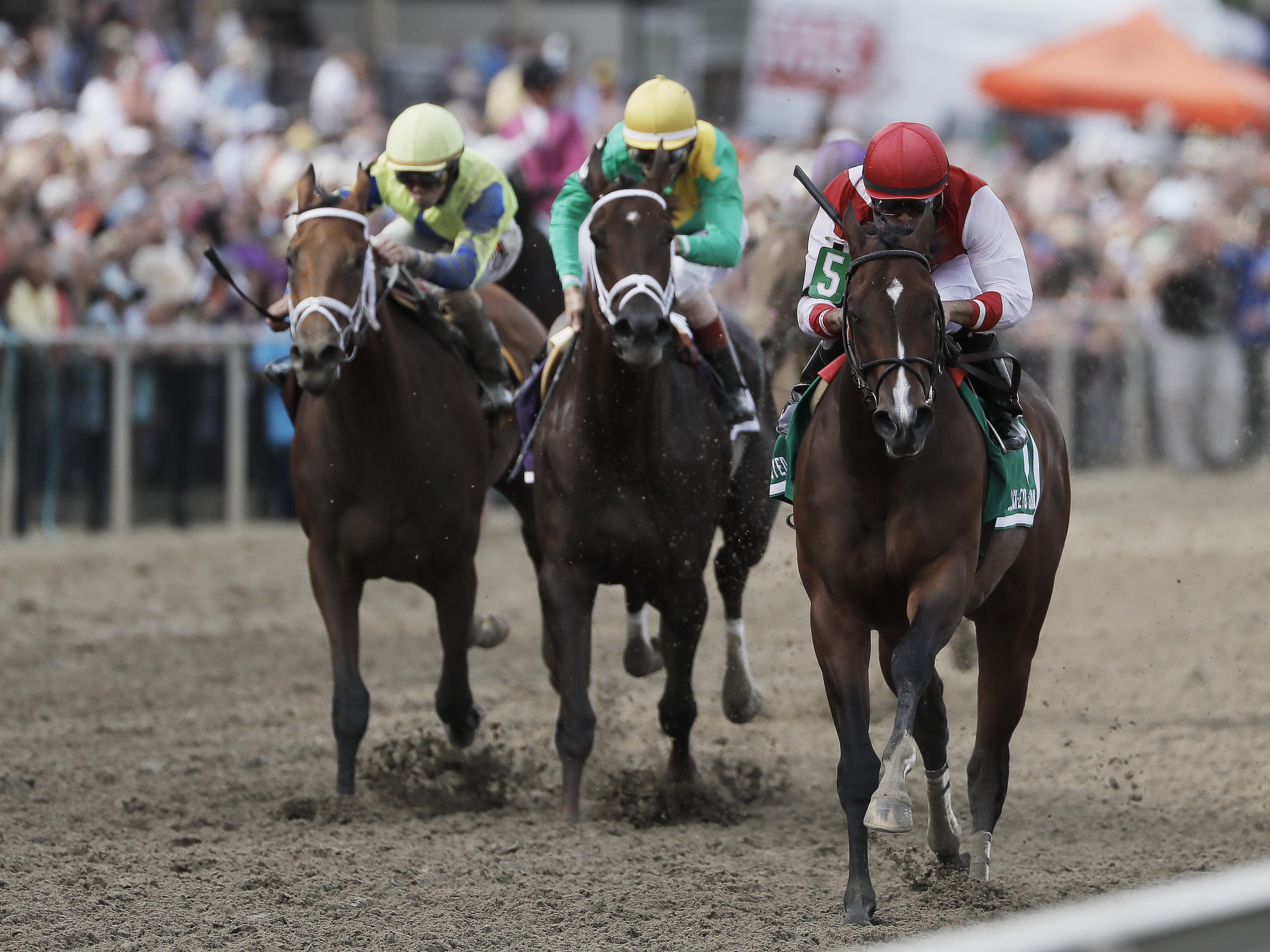 Go Maggie Go with Luis Saez aboard, right, wins the Black-Eyed Susan horse race at Pimlico Race Course as Kinsley Kisses with John Velazquez center and rider Brian Hernandez Jr. rides Ma Can Do It, come in Friday, May 20, 2016, in Baltimore. The 141st Pre