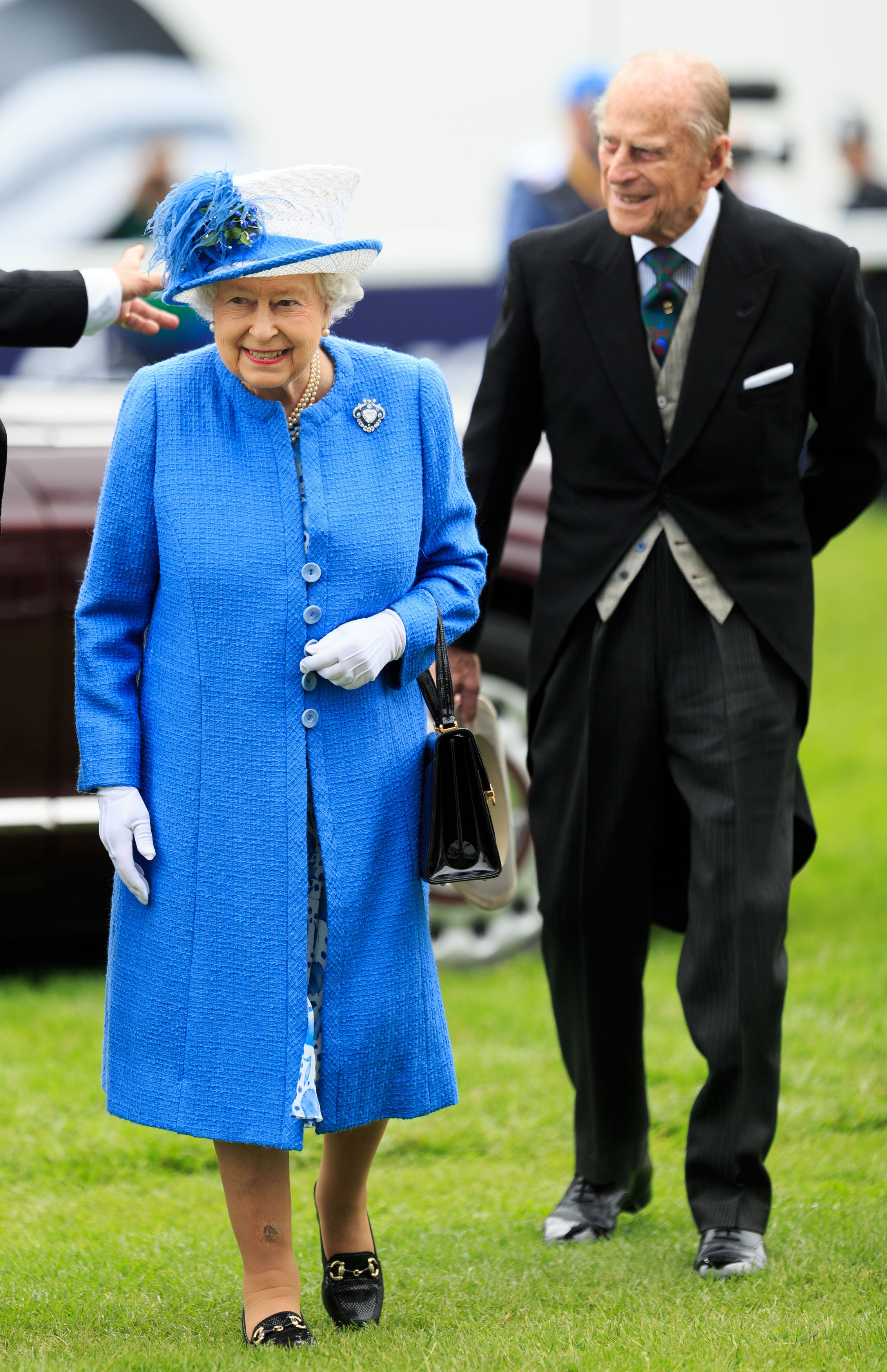 Queen Elizabeth II arrives with her husband the Duke of Edinburgh for Derby Day of the 2016 Epsom Derby Festival at Epsom Racecourse, southern England, Saturday June 4, 2016. (John Walton/ PA via AP) UNITED KINGDOM OUT - NO SALES - NO ARCHIVES