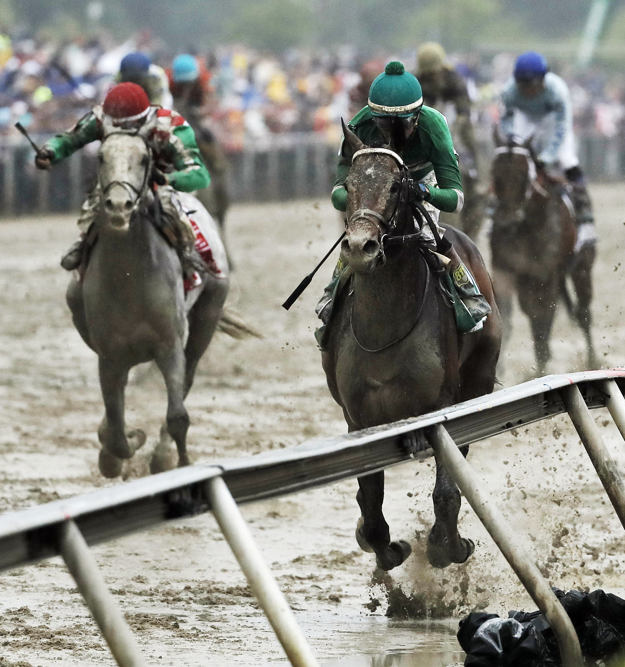 FILE - In this May 21, 2016, file photo, jockey Kent Desormeaux rides Exaggerator to win the 141st Preakness Stakes horse race at Pimlico Race Course in Baltimore. Next Saturday there'll be no Triple try. No Kentucky Derby winner, either. And no sellout c
