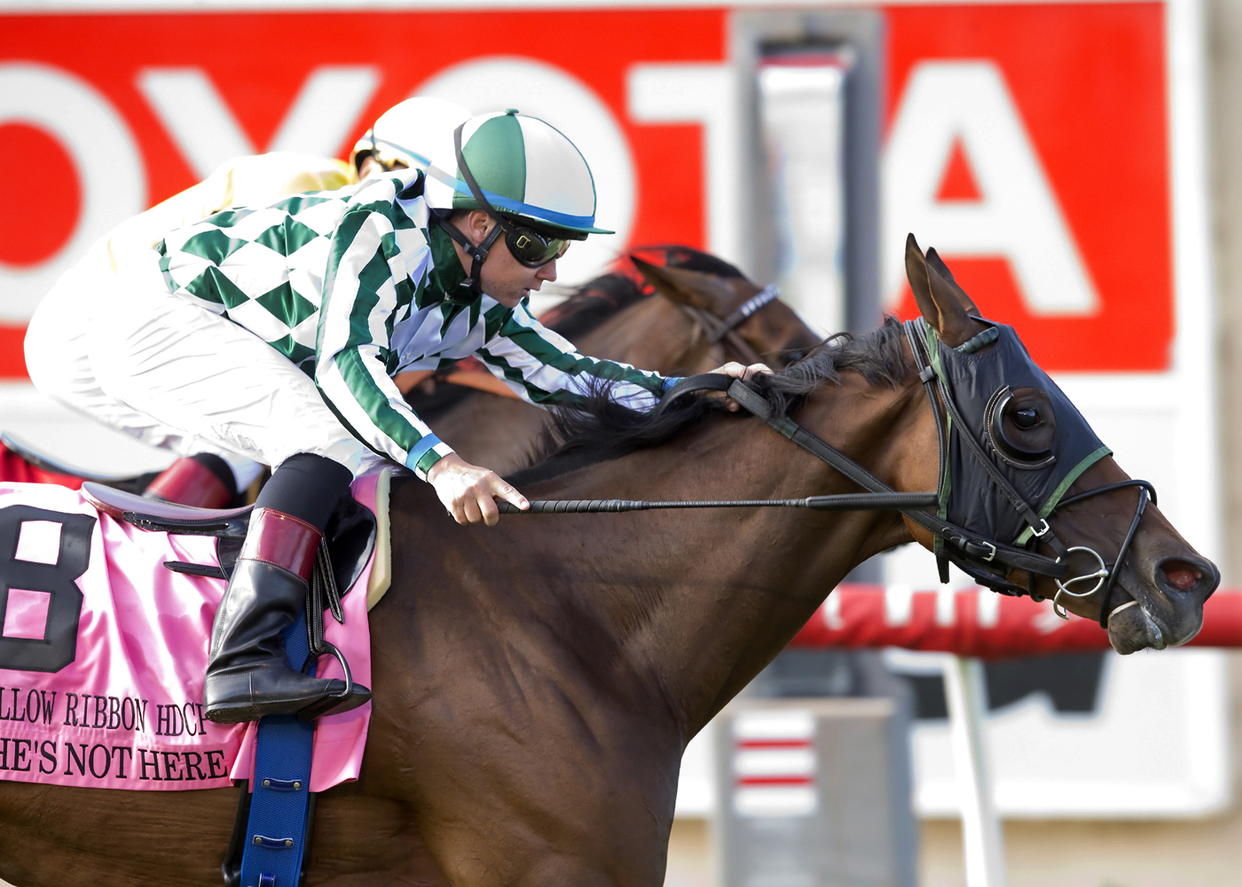 In a photo provided by Benoit Photo, She's Not Here and jockey Drayden Van Dyke, foreground, overpower Fresh Feline, rear, with Victor Espinoza, to win the Grade II, $200,000 Yellow Ribbon Handicap horse race Saturday, July 16, 2016, at Del Mar Thoroughbr