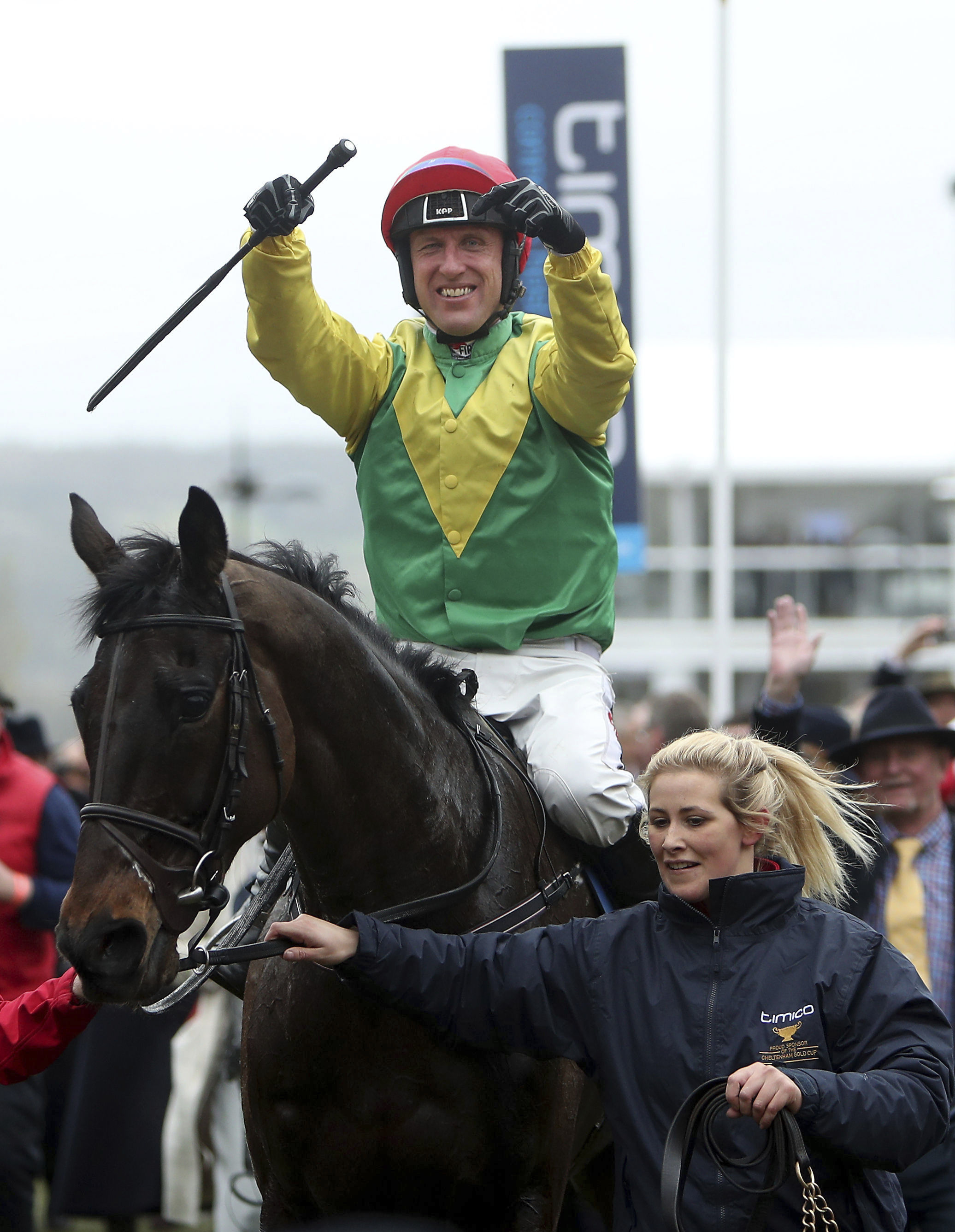Jockey Robbie Power celebrates after his winning ride on Sizing John in the Cheltenham Gold Cup on the final day of the 2017 Cheltenham Festival at Cheltenham Racecourse Cheltenham England, Friday March 17, 2017. (David Davies/PA  via AP)