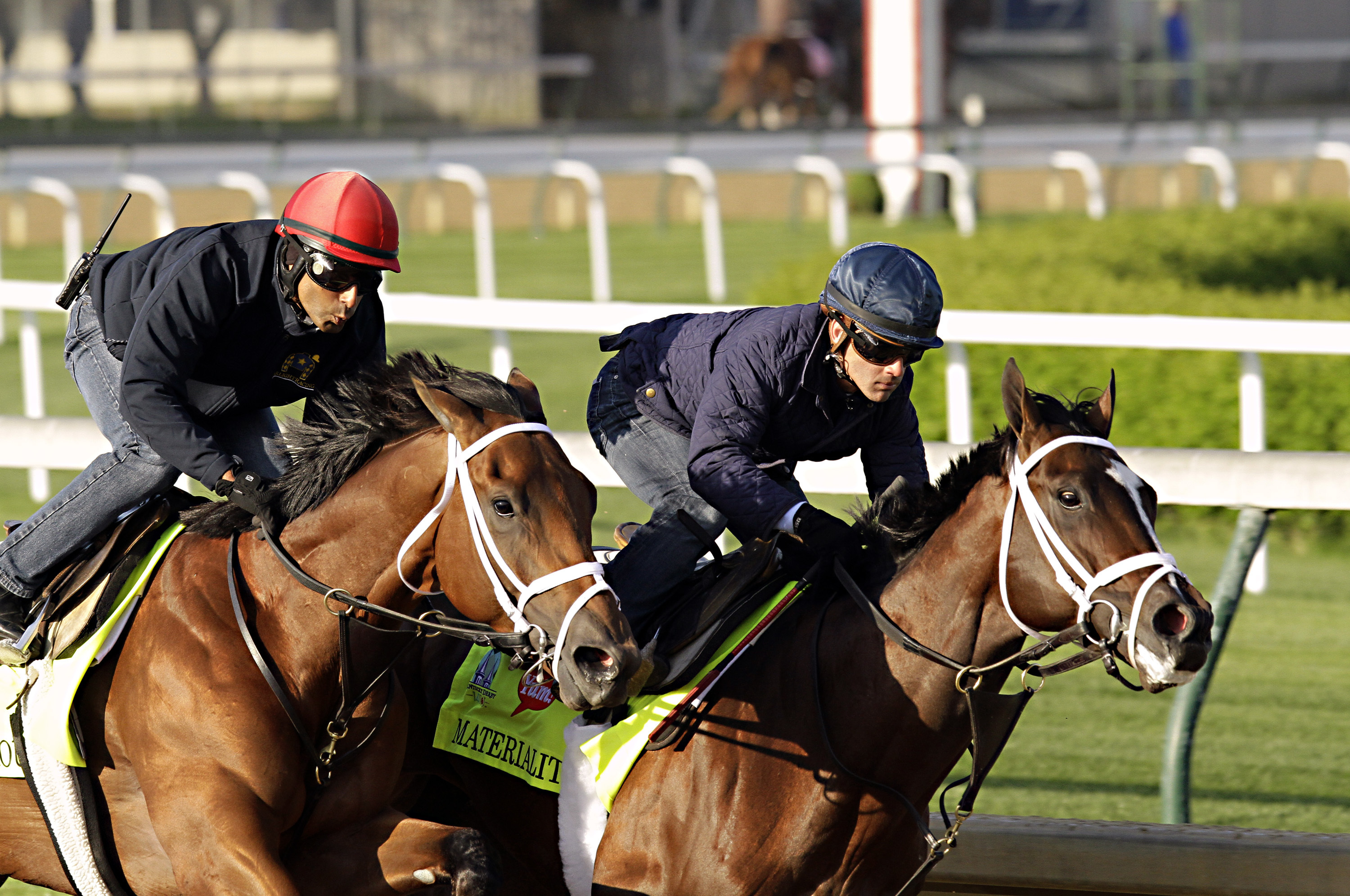 FILE - In this April 24, 2015, file photo, jockey Javier Castellano, right, gets Kentucky Derby hopeful Materiality in front of stablemate Itsaknockout, left, with exercise rider Ezequiel Perez, during a morning workout at Churchill Downs in Louisville, K