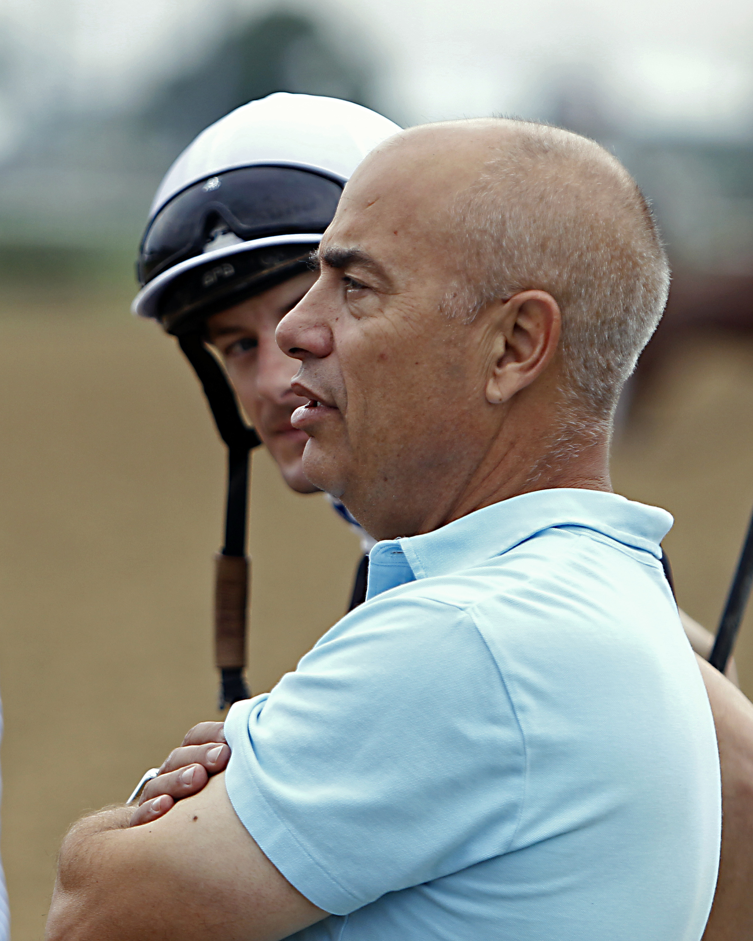 Trainer Mark Casse, right, talks with jockey Julien Leparoux along the racetrack while watching horses work out at Churchill Downs in Louisville, Ky., Sunday, Apr. 30, 2017. Leparoux will ride Casse's Classic Empire in the 143rd Kentucky Derby on May 6. (