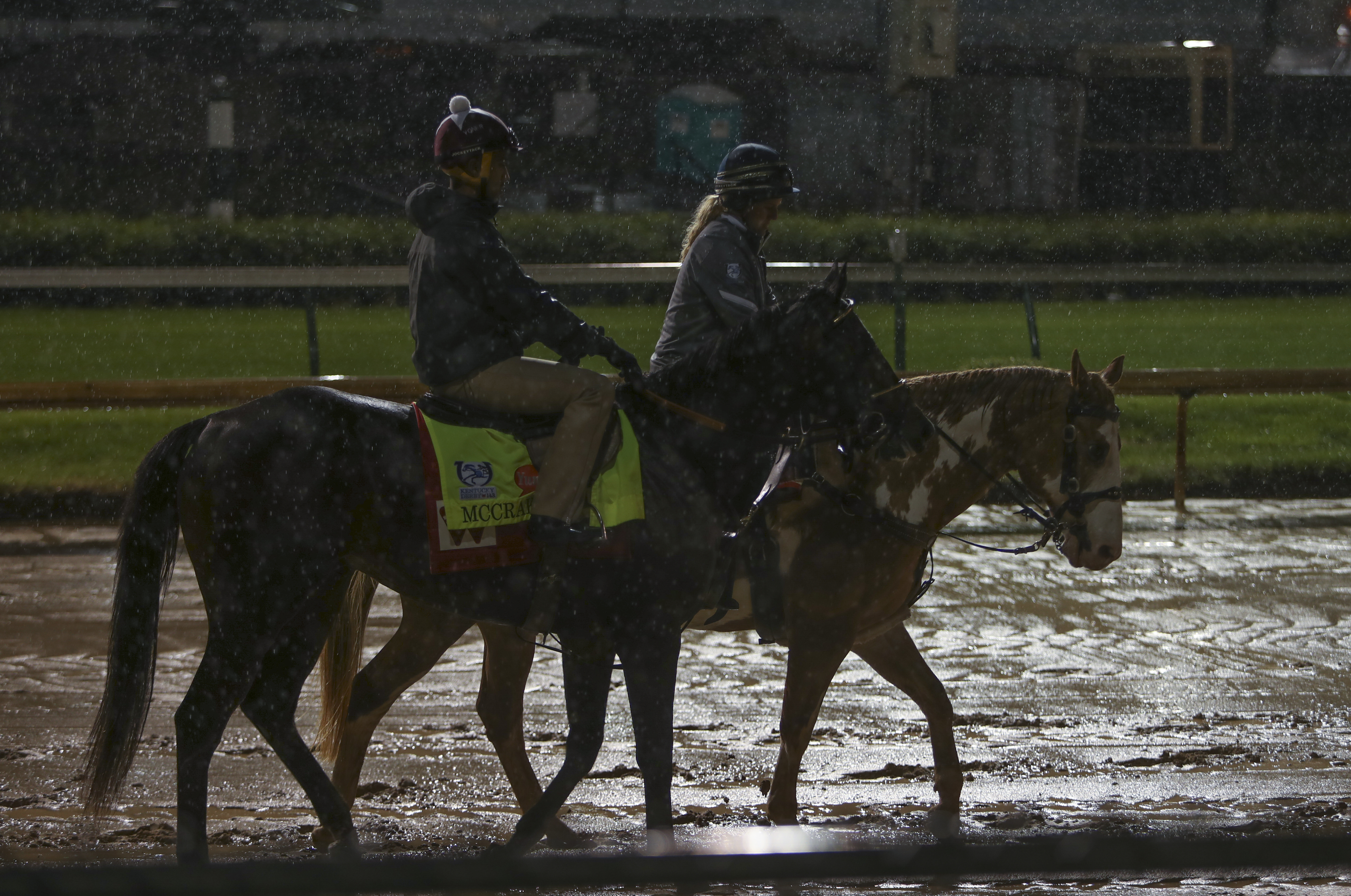Kentucky Derby entrant McCracken, left, ridden by exercise rider Yoni Orantes, goes out for an early morning practice run for the 143rd running of the Kentucky Derby horse race at Churchill Downs Friday, May 5, 2017, in Louisville, Ky. (AP Photo/Garry Jon