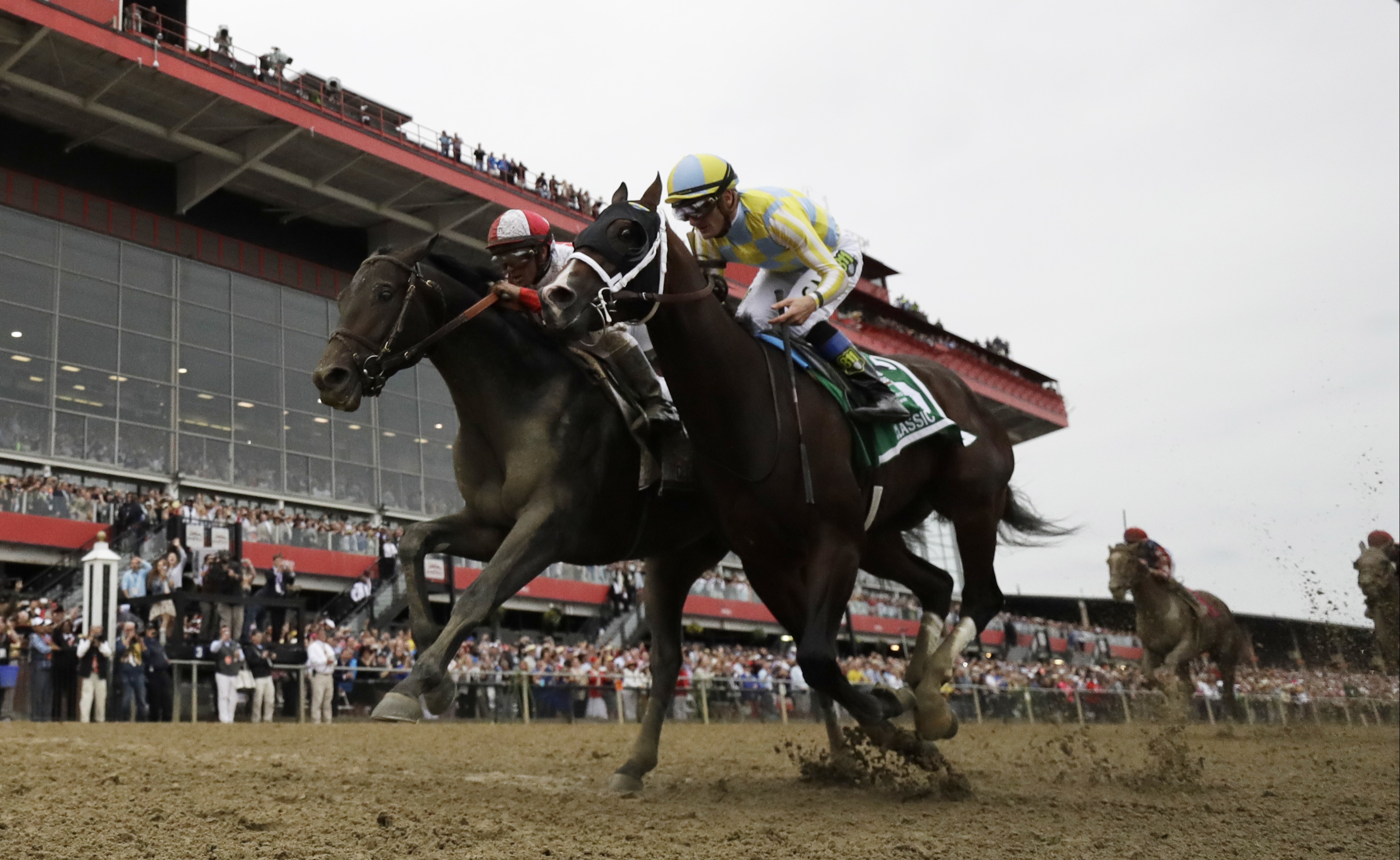 Cloud Computing (2), ridden by Javier Castellano, left, wins 142nd Preakness Stakes horse race at Pimlico race course as Classic Empire (5) with Julien Leparoux aboard takes second, Saturday, May 20, 2017, in Baltimore. (AP Photo/Matt Slocum)