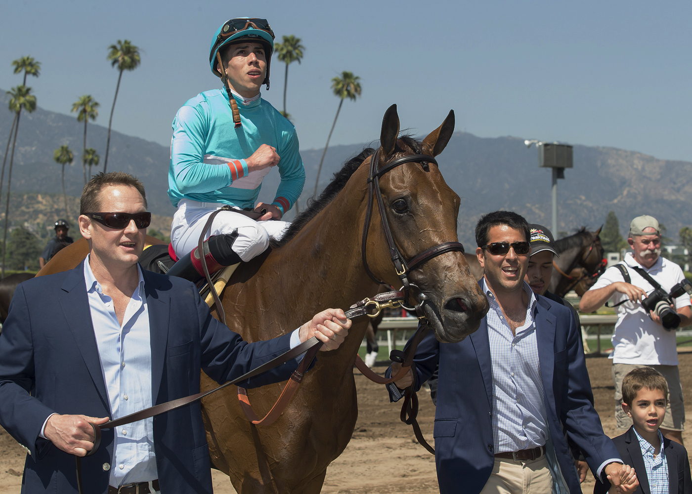 Owner Sol Kumin, right, guides Lady Eli, with Irad Ortiz Jr., into the winner's circle after their victory in the Grade I, $300,000 Gamely Stakes at Santa Anita Park in Arcadia Calif., Saturday, May 27, 2017. Lady Eli won the $300,000 Gamely Stakes for fi