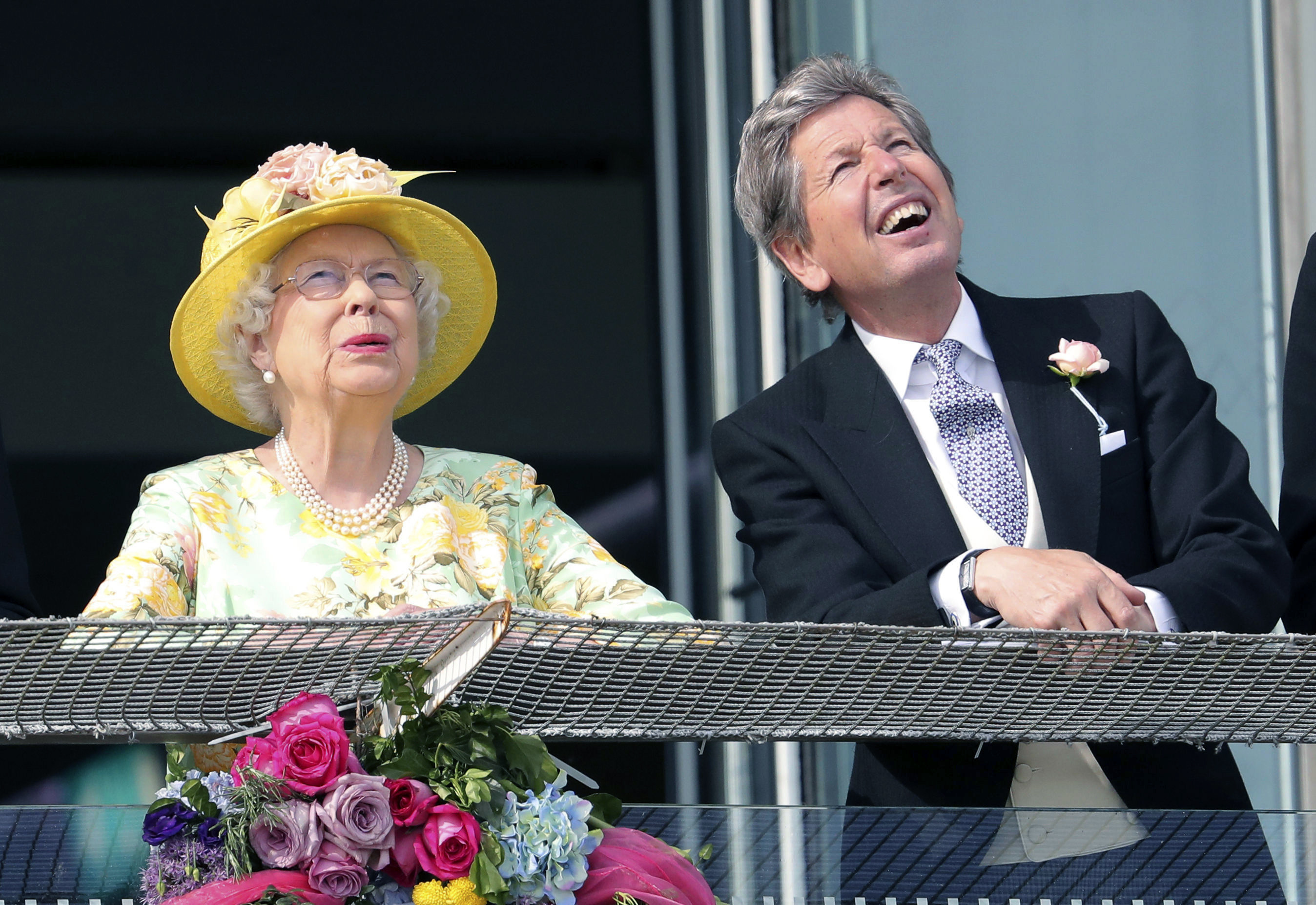 Queen Elizabeth II with her racing manager John Warren, right on Derby Day of the 2017 Epsom Derby Festival at Epsom Racecourse, in Epsom, England. Saturday June 3, 2017. (Andrew Matthews/PA via AP)