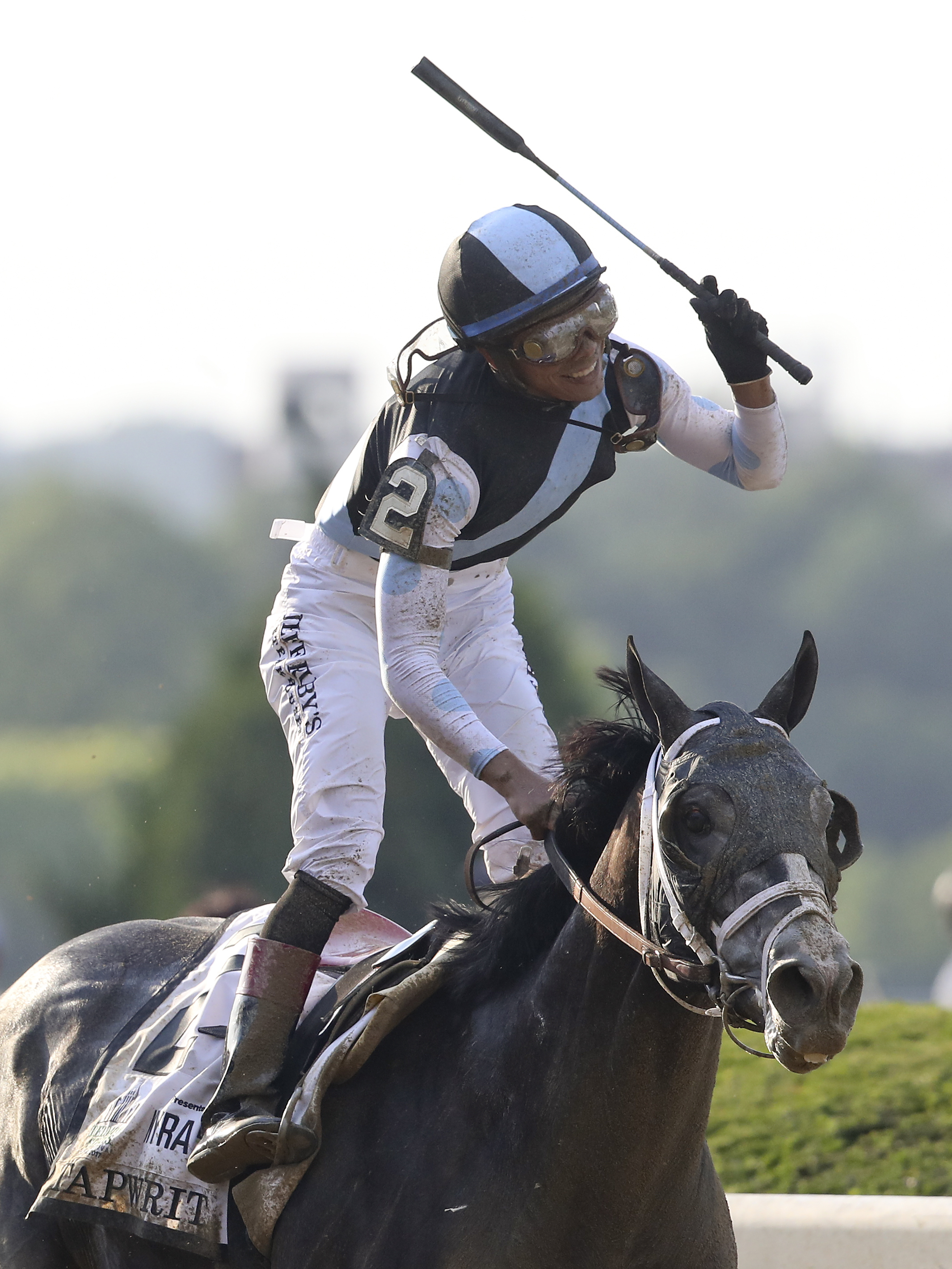 Jose Ortiz celebrates after riding Tapwrit to victory in the 149th running of the Belmont Stakes horse race, Saturday, June 10, 2017, in Elmont, N.Y. (AP Photo/Mary Altaffer)