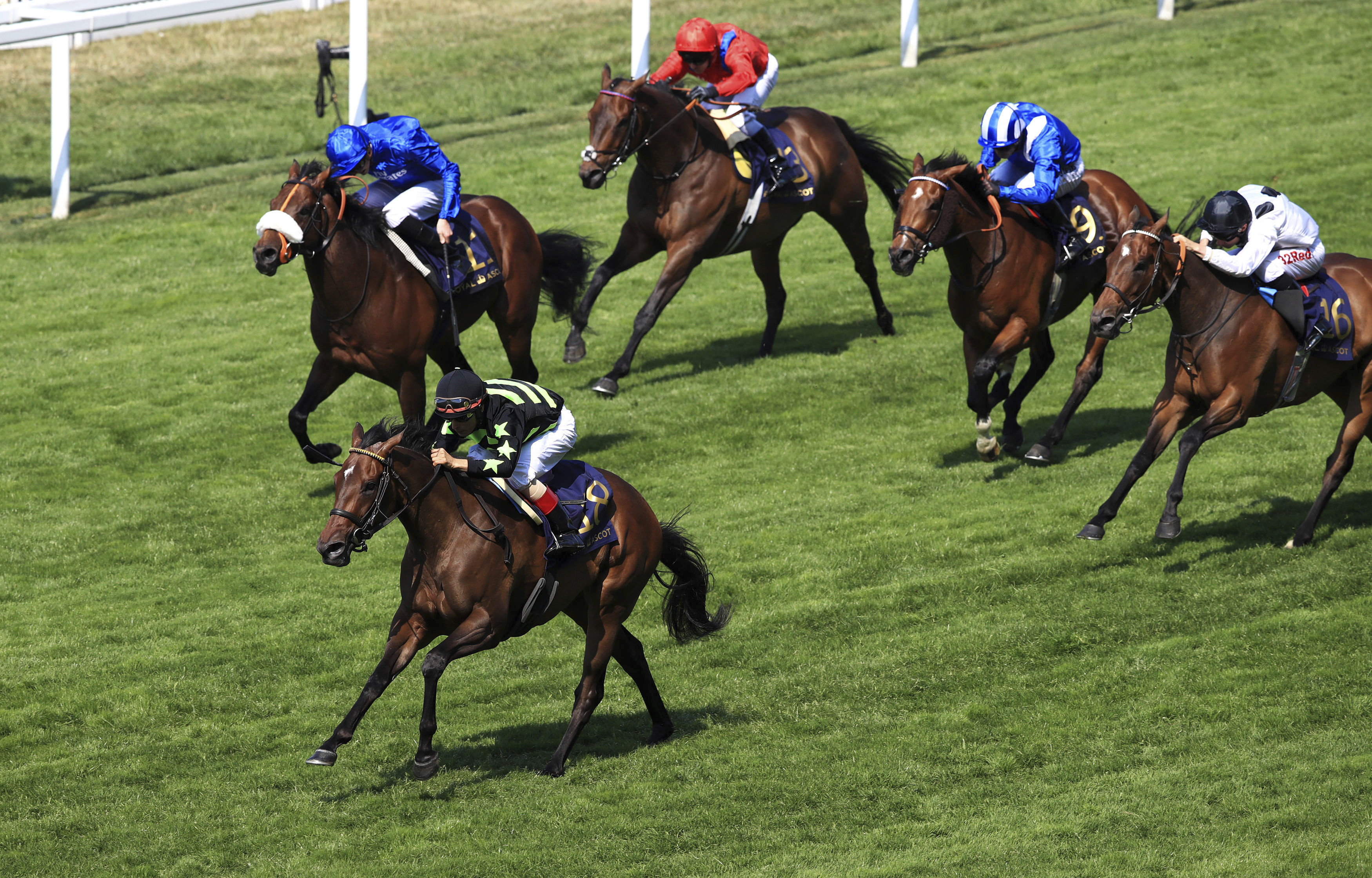 Lady Aurelia ridden by jockey John Velazquez, leads the field as they come home to win the King's Stand Stakes during day one of Royal Ascot at Ascot Racecourse Ascot England Tuesday June 20, 2017. American filly Lady Aurelia won at Royal Ascot for the se
