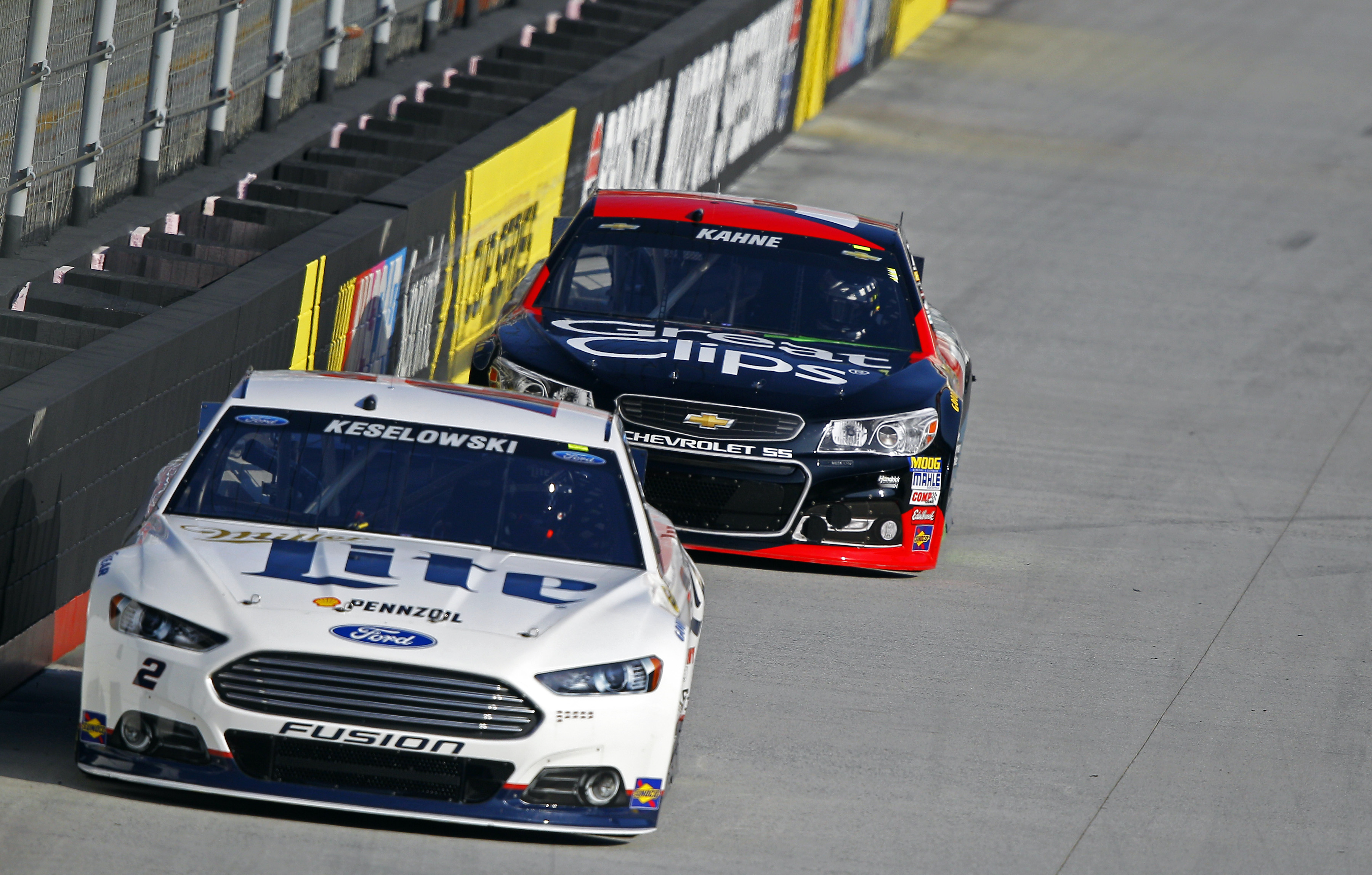 Driver Brad Keselowski leads Kasey Kahne during practice for a NASCAR Sprint Cup Series auto race at Bristol Motor Speedway on Saturday, April 18, 2015, in Bristol, Tenn. (AP Photo/Wade Payne)
