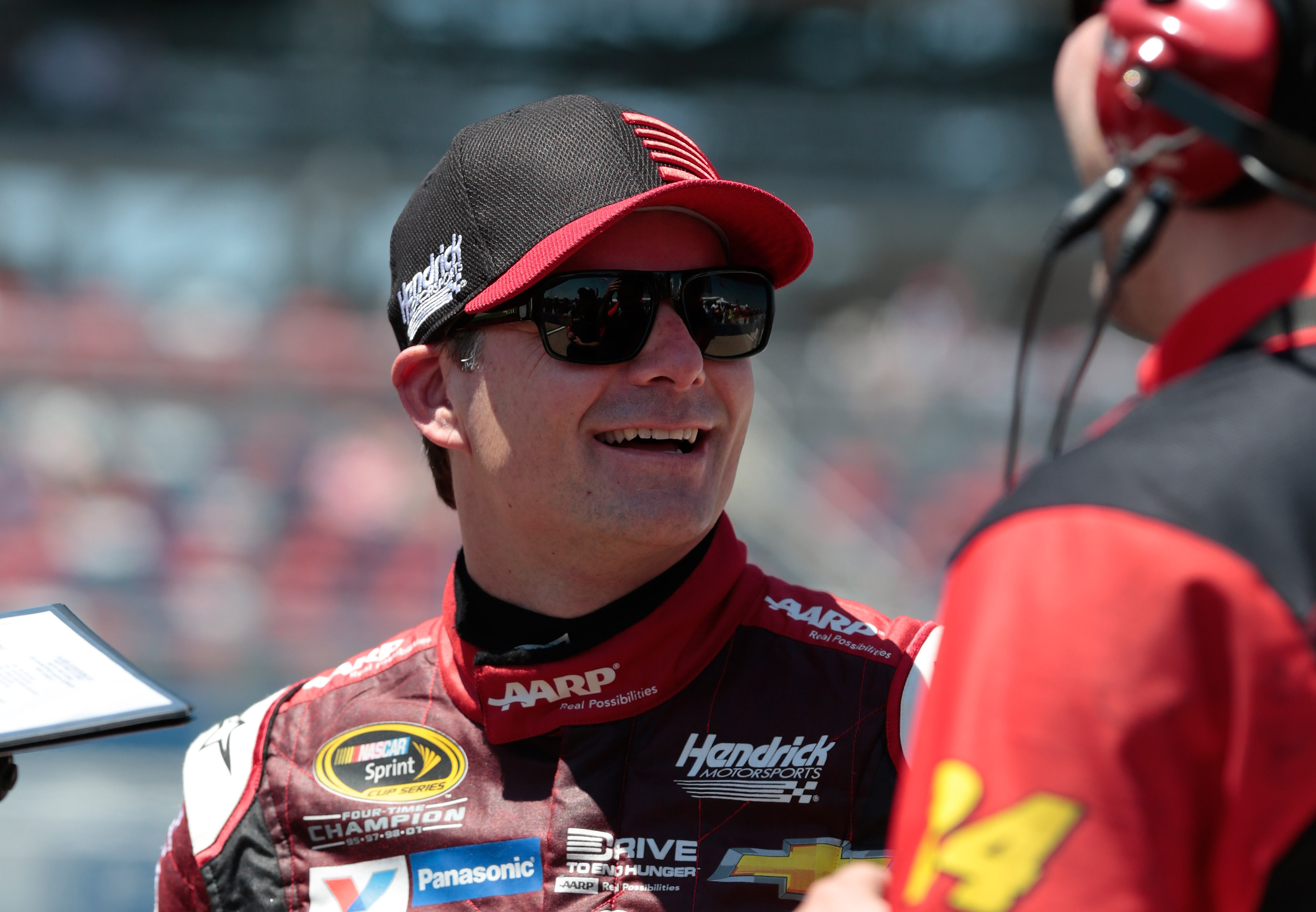Driver Jeff Gordon smiles during qualifying for the NASCAR Sprint Cup Series auto race at Talladega Superspeedway, Saturday, May 2, 2015, in Talladega, Ala. Gordon, who is in his last season, qualified first for the pole. (AP Photo/Butch Dill)