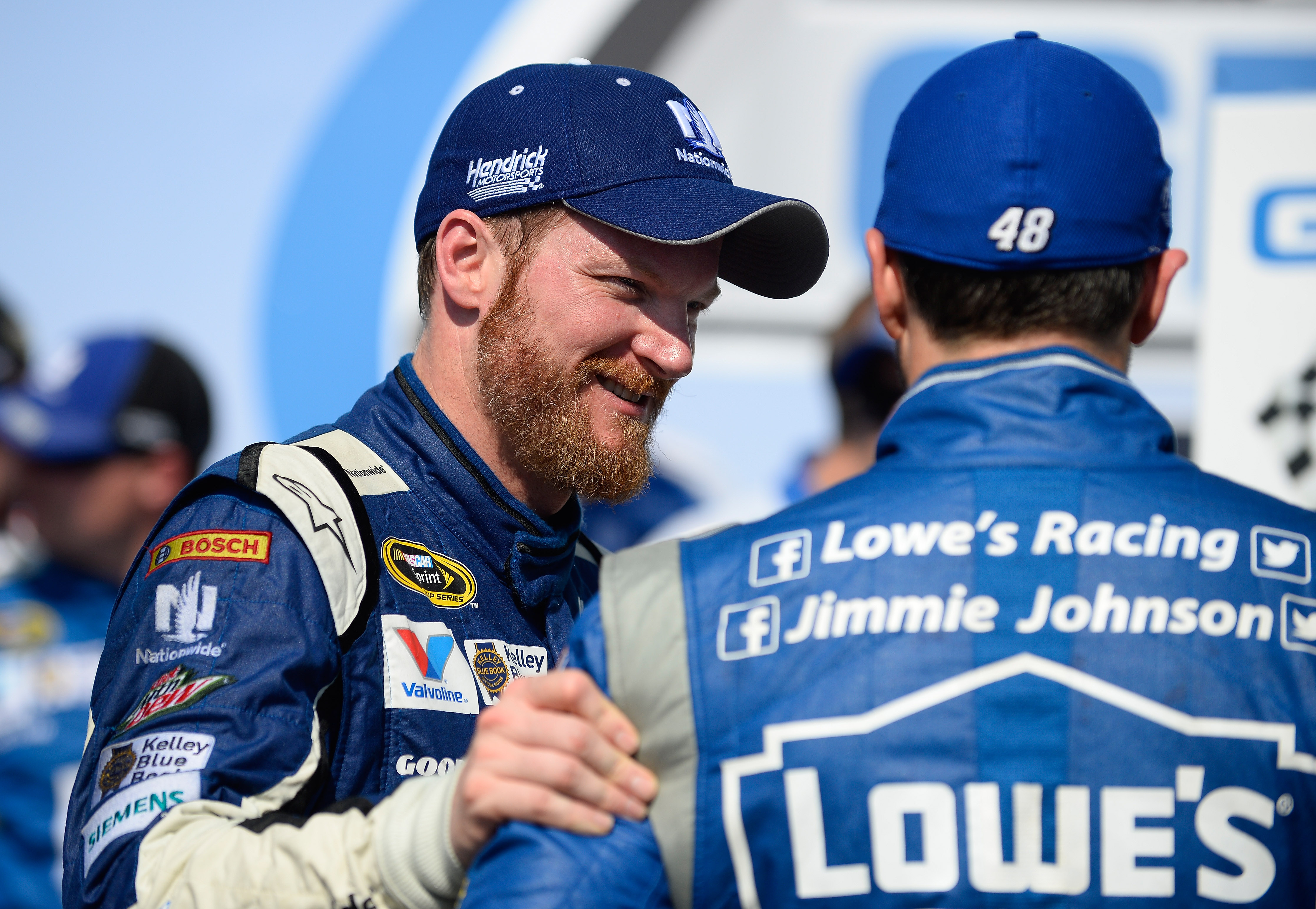 Dale Earnhardt Jr., left, talks to Jimmie Johnson, right, in Victory Lane after winning the Talladega 500 NASCAR Sprint Cup Series auto race at Talladega Superspeedway, Sunday, May 3, 2015, in Talladega, Ala. (AP Photo/David Tulis)