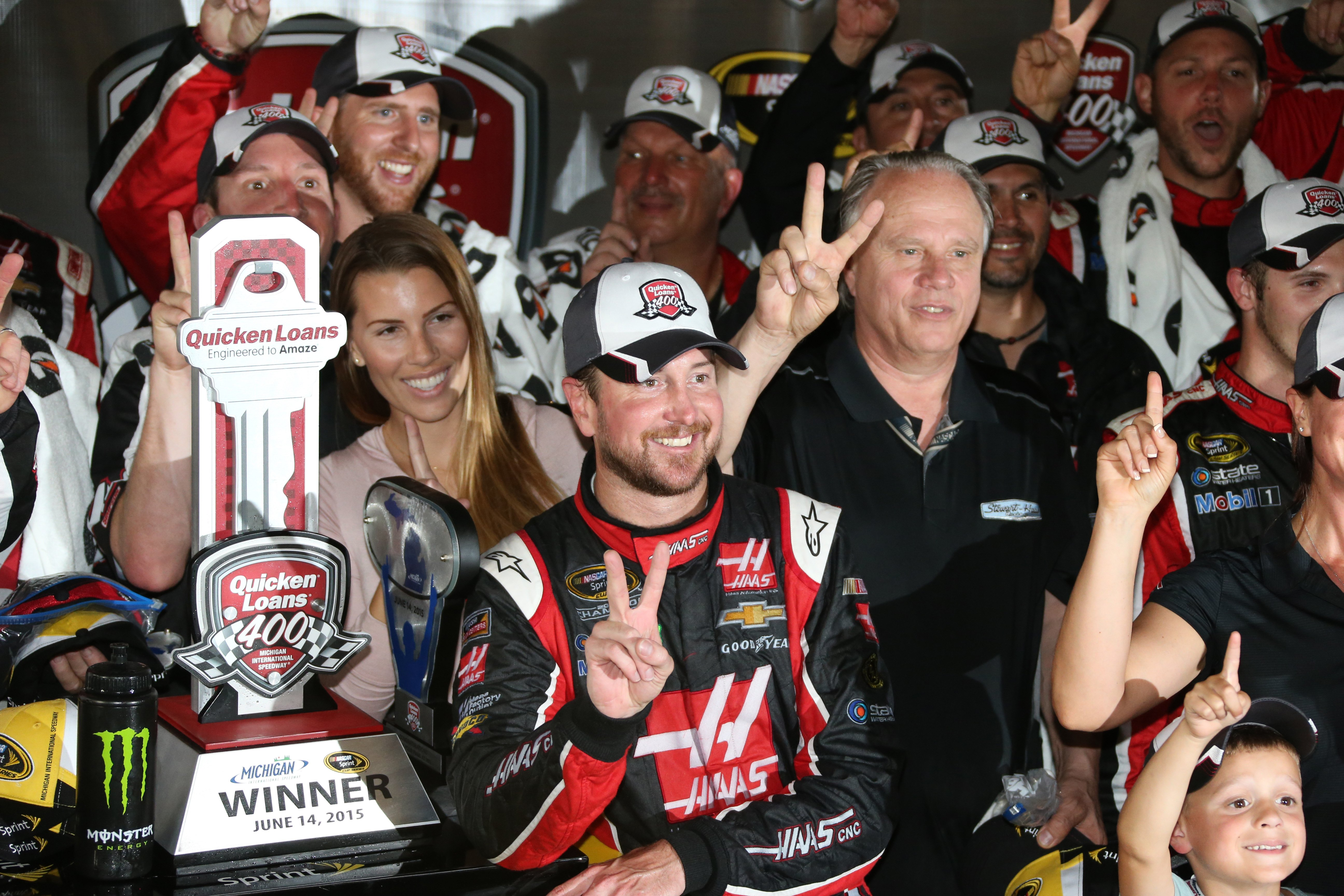 Kurt Busch celebrates in the winner's circle after the NASCAR Sprint Cup series auto race at Michigan International Speedway, Sunday, June 14, 2015, in Brooklyn, Mich. (AP Photo/Bob Brodbeck)