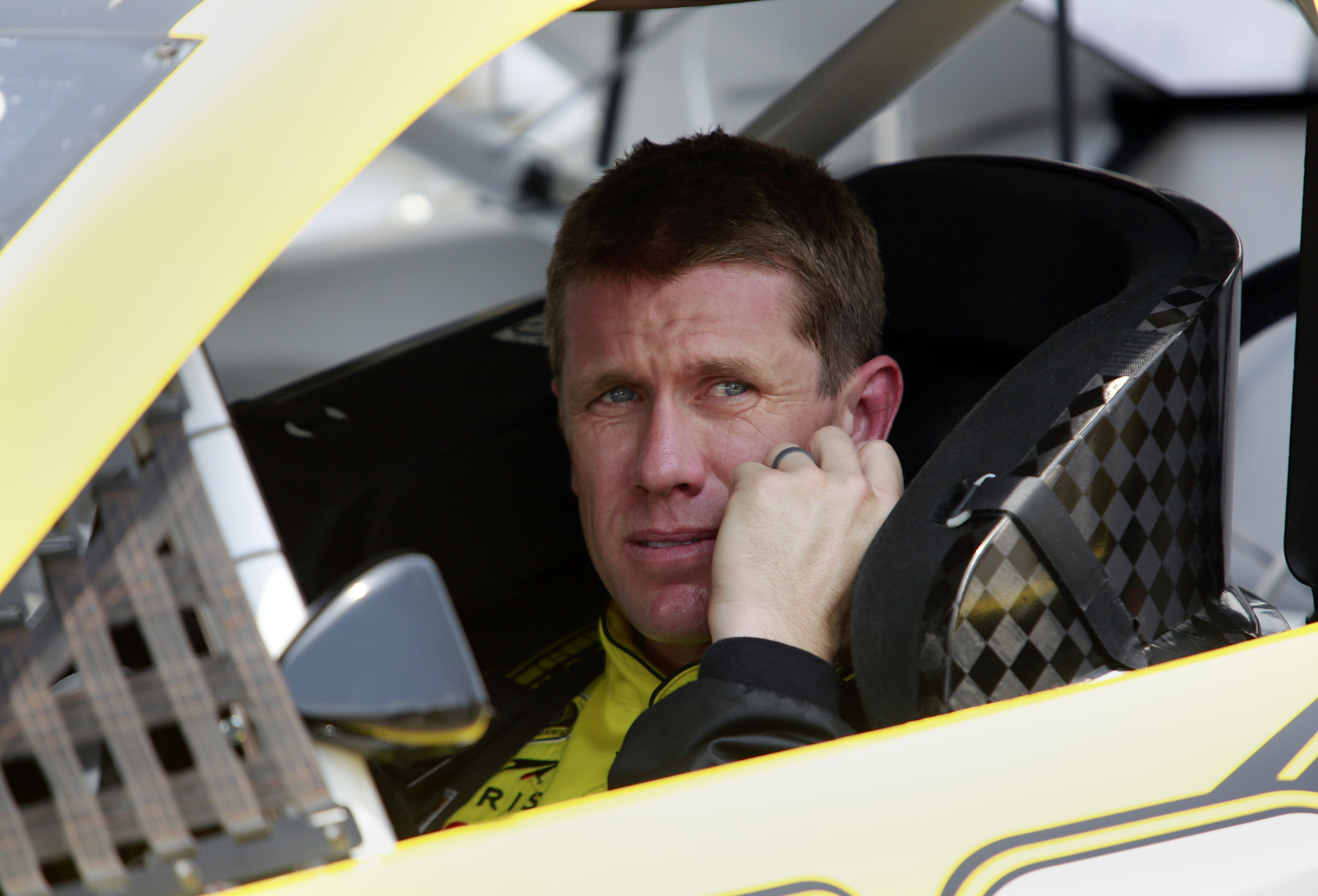 Sprint Cup Series driver Carl Edwards (19) sits in his car during qualifying for the NASCAR Brickyard 400 auto race at Indianapolis Motor Speedway in Indianapolis, Saturday, July 25, 2015. (AP Photo/R Brent Smith)