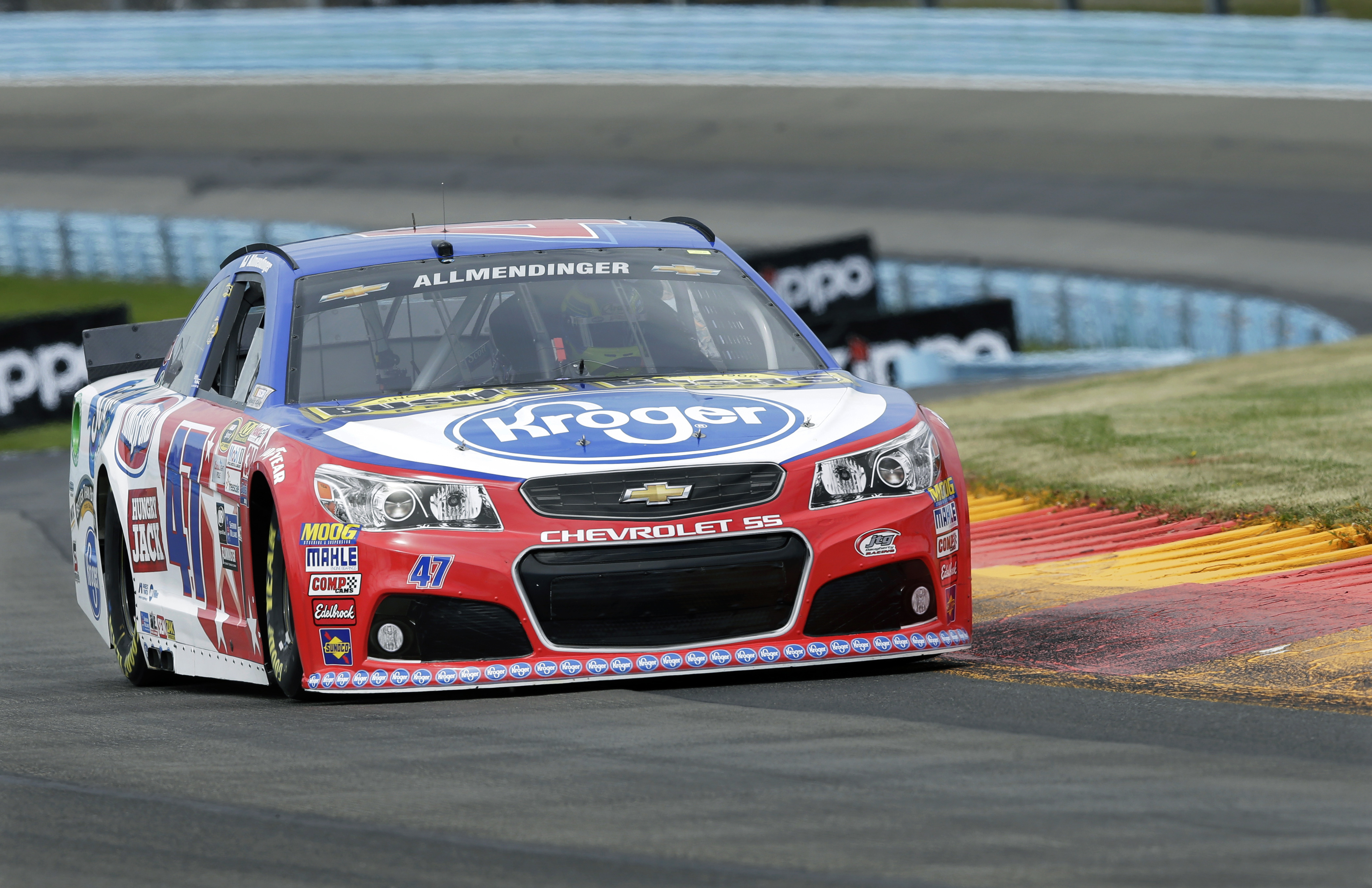 AJ Allmendinger (47) drives during qualifying for Sunday's NASCAR Sprint Cup series auto race at Watkins Glen International, Saturday, Aug. 8, 2015, in Watkins Glen, N.Y. Allmendinger won the pole position for Sunday's race. (AP Photo/Mel Evans)
