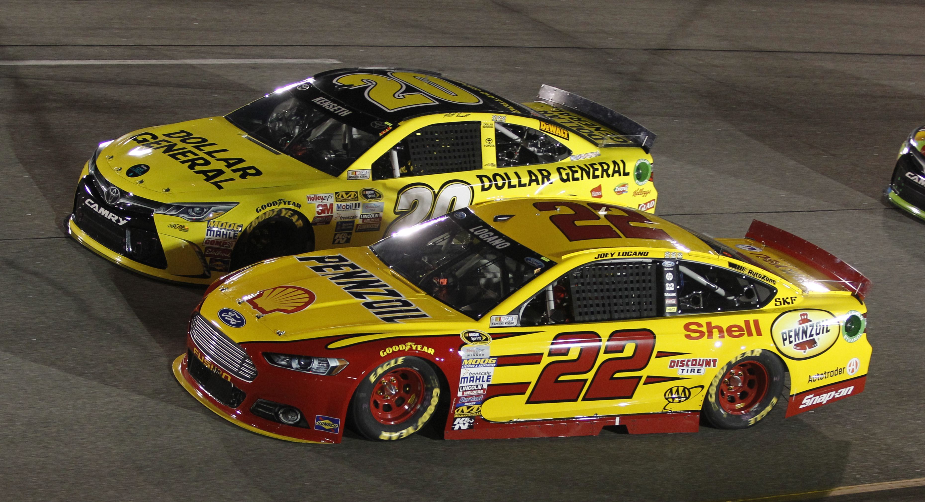 Joey Logano (22) and Sprint Cup Series driver Matt Kenseth (20) race for position during the NASCAR Sprint Cup auto race at Richmond International Raceway on Saturday Sept. 12, 2015.  (AP Photo/Jesse Hutchinson)