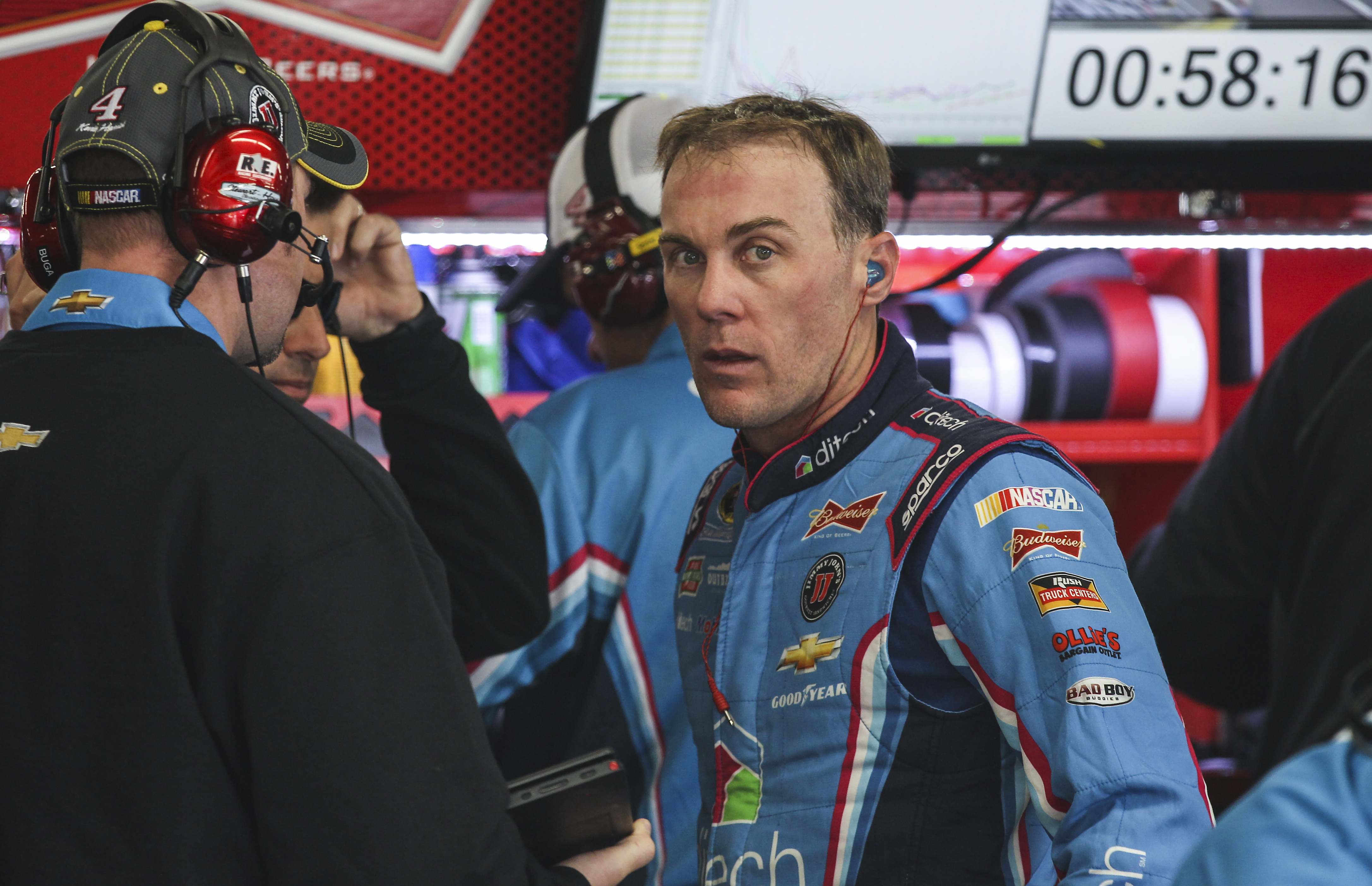 Driver Kevin Harvick waits in the garage while his car is worked on during practice for Sunday's NASCAR Sprint Cup series auto race at New Hampshire Motor Speedway in Loudon, N.H., Friday, Sept. 25, 2015  (AP Photo/Cheryl Senter)