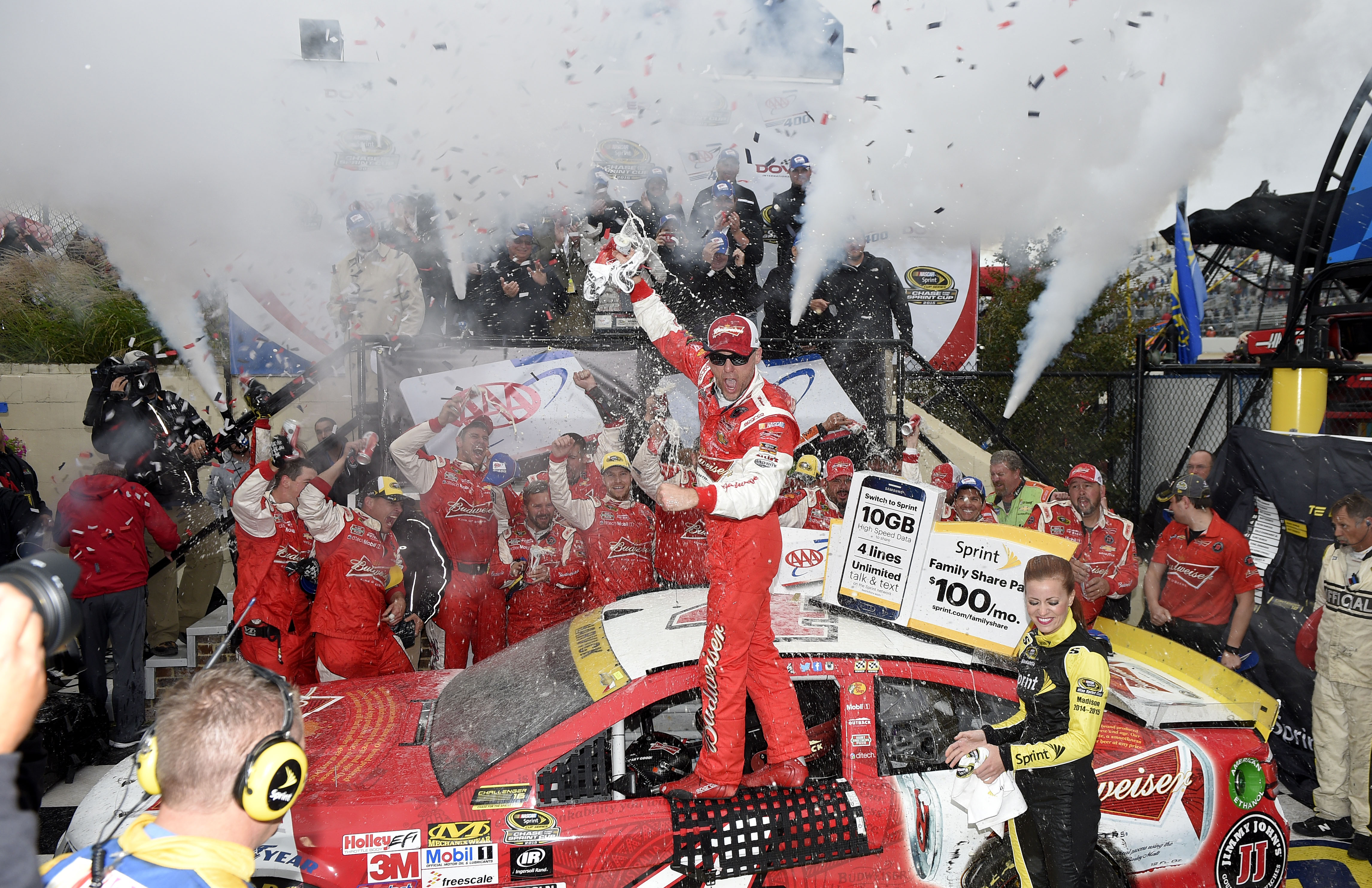 Kevin Harvick celebrates in Victory Lane after he won the NASCAR Sprint Cup series auto race, Sunday, Oct. 4, 2015, at Dover International Speedway in Dover, Del. (AP Photo/Nick Wass)