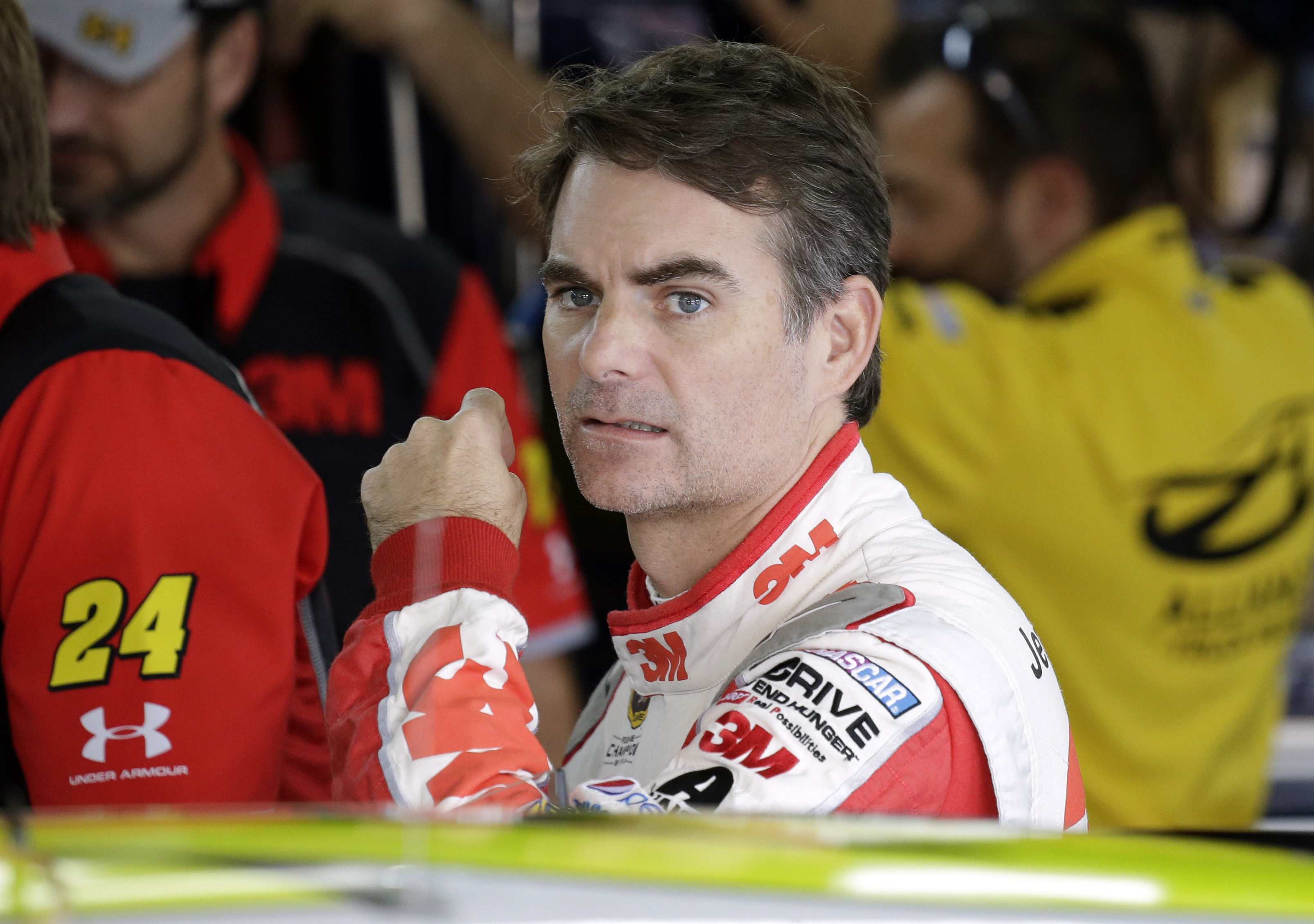 Jeff Gordon looks from the garage before practice for Saturday's NASCAR Sprint Cup series auto race at Charlotte Motor Speedway in Concord, N.C., Friday, Oct. 9, 2015. (AP Photo/Terry Renna)