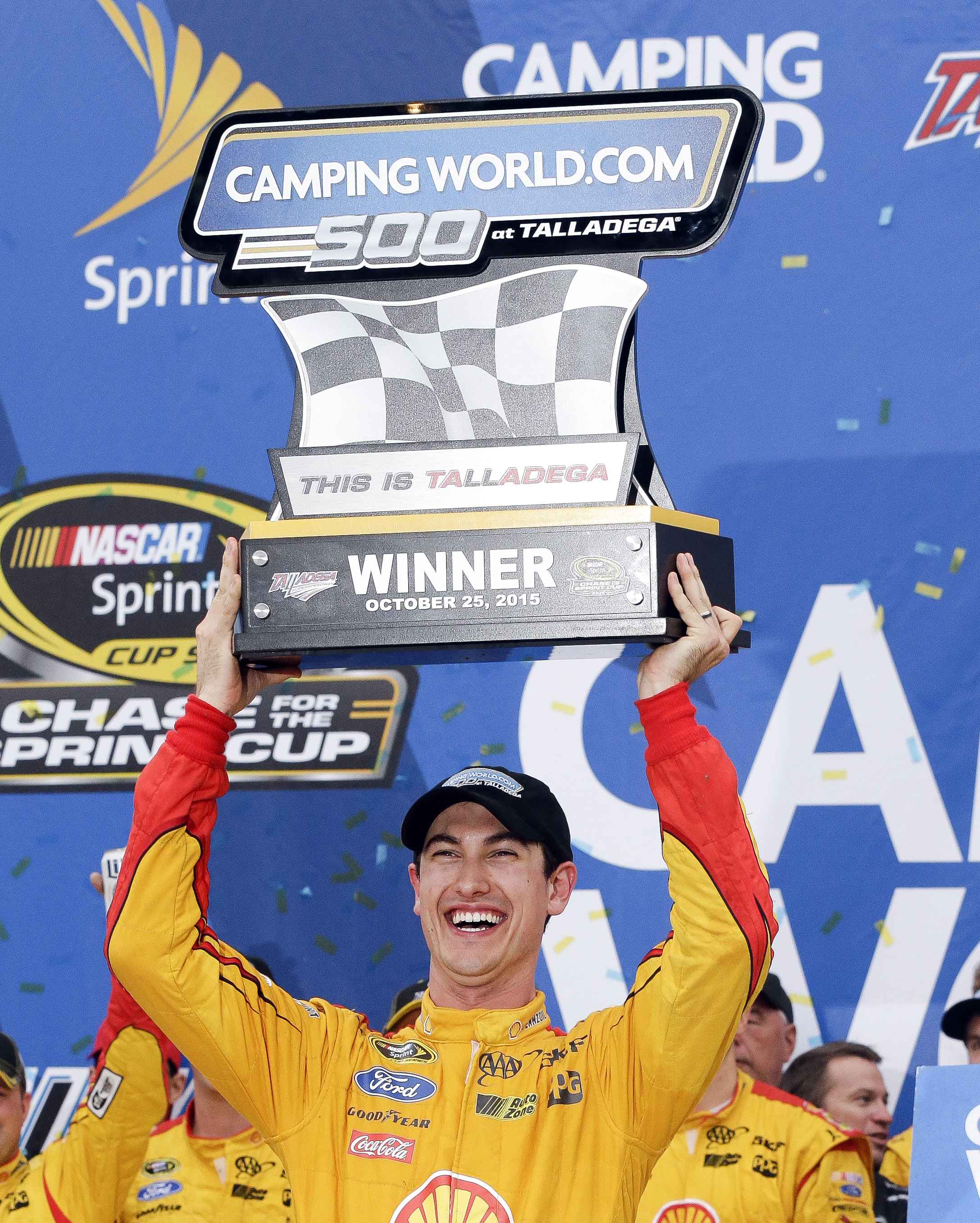 Sprint Cup Series driver Joey Logano (22) holds up the trophy after winning the during the NASCAR Sprint Cup Series auto race at Talladega Superspeedway Sunday, Oct. 25, 2015, in Talladega, Ala. (AP Photo/Butch Dill)
