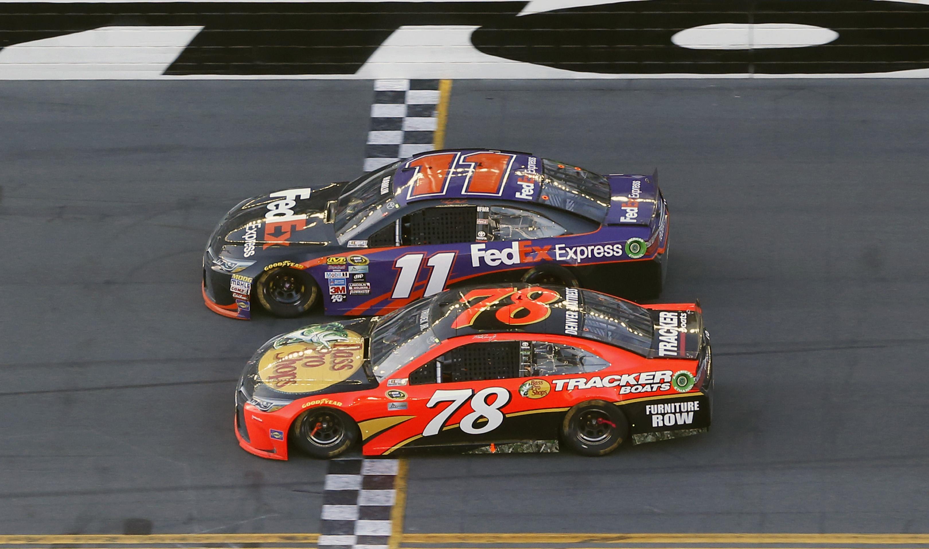 Denny Hamlin (11) beats out Martin Truex Jr. (78) at the finish line to win the NASCAR Daytona 500 auto race at Daytona International Speedway, Sunday, Feb. 21, 2016, in Daytona Beach, Fla. (AP Photo/Wilfredo Lee)