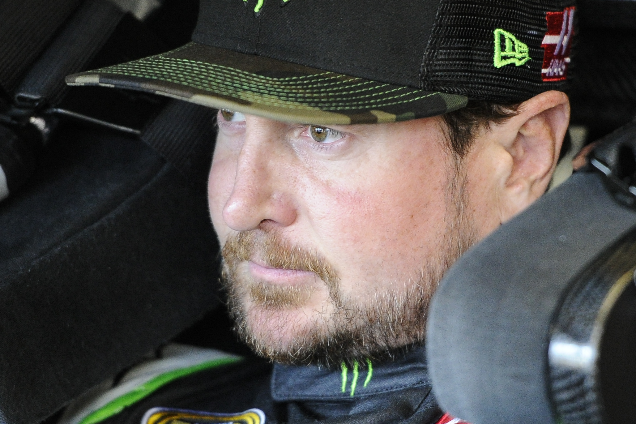 Pole winner Kurt Busch sits in his car during practice at Atlanta Motor Speedway Saturday, Feb. 27, 2016, in Hampton, Ga., for Sunday's NASCAR Sprint Cup auto race. (AP Photo/John Amis)