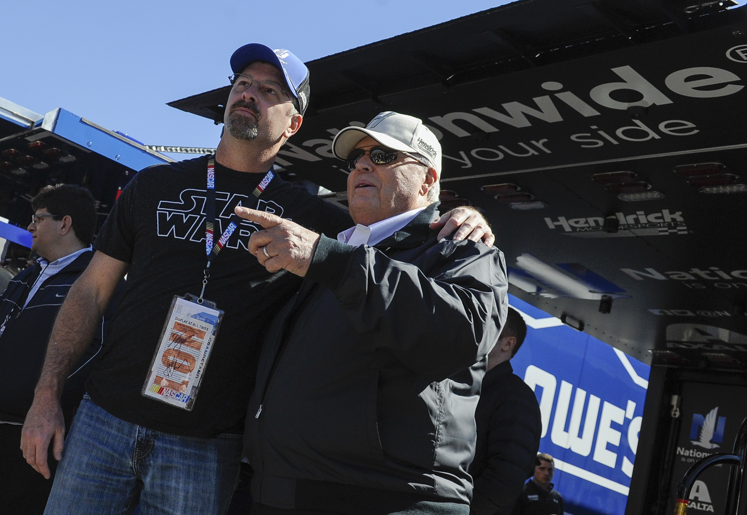 Team Owner Rick Hendrick, right, has pictures made with fans before a NASCAR Sprint Cup Series auto race at Atlanta Motor Speedway Sunday, Feb. 28, 2016, in Hampton, Ga. (AP Photo/John Amis)