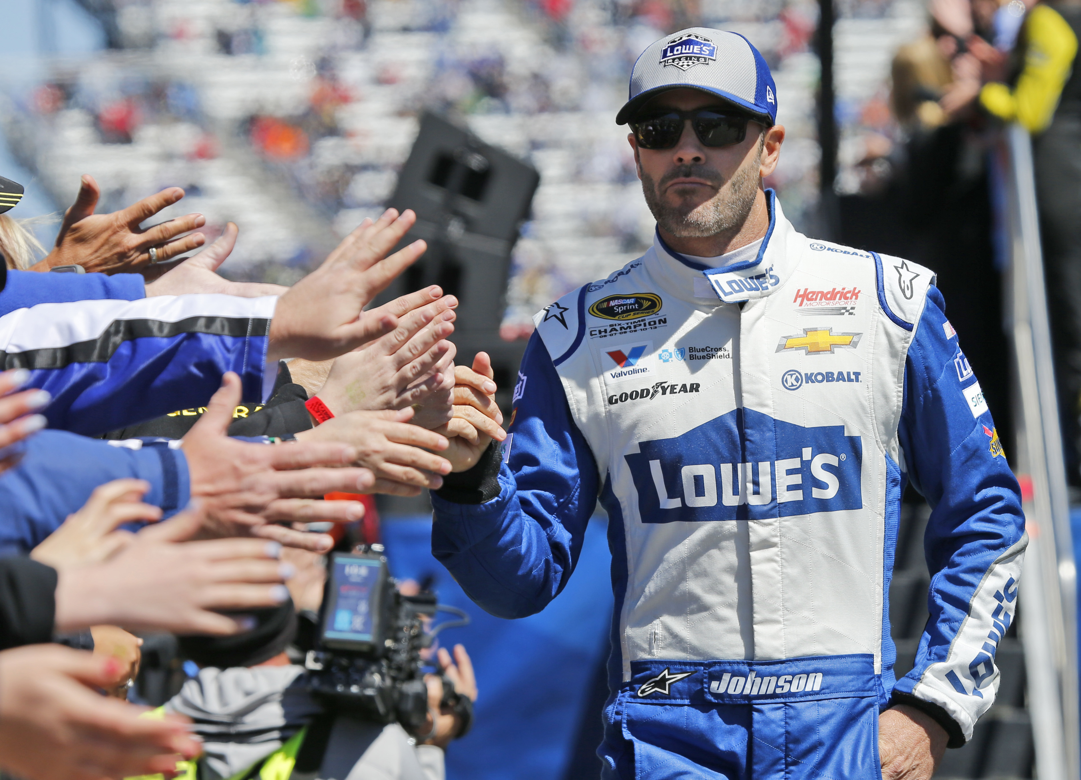 Driver Jimmie Johnson greets fans during driver introductions for the Sprint Cup auto race at Martinsville Speedway on Sunday, April 3, 2016, in Martinsville, Va. (AP Photo/Steve Helber)