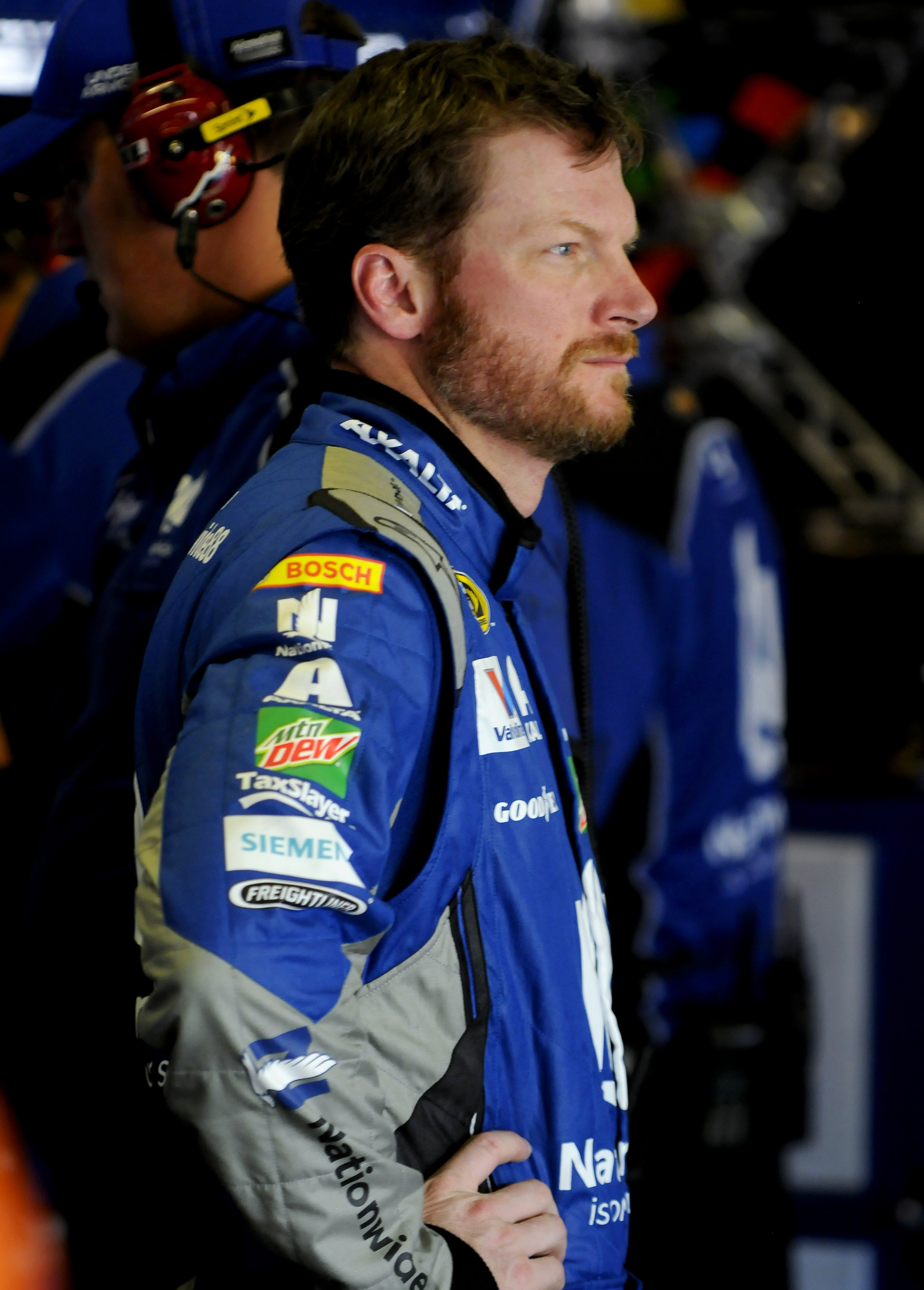 Dale Earnhardt Jr. stands in a garage during practice for the NASCAR Sprint Cup Series auto race at Texas Motor Speedway in Fort Worth, Texas, Thursday, April 7, 2016. (AP Photo/Ralph Lauer)