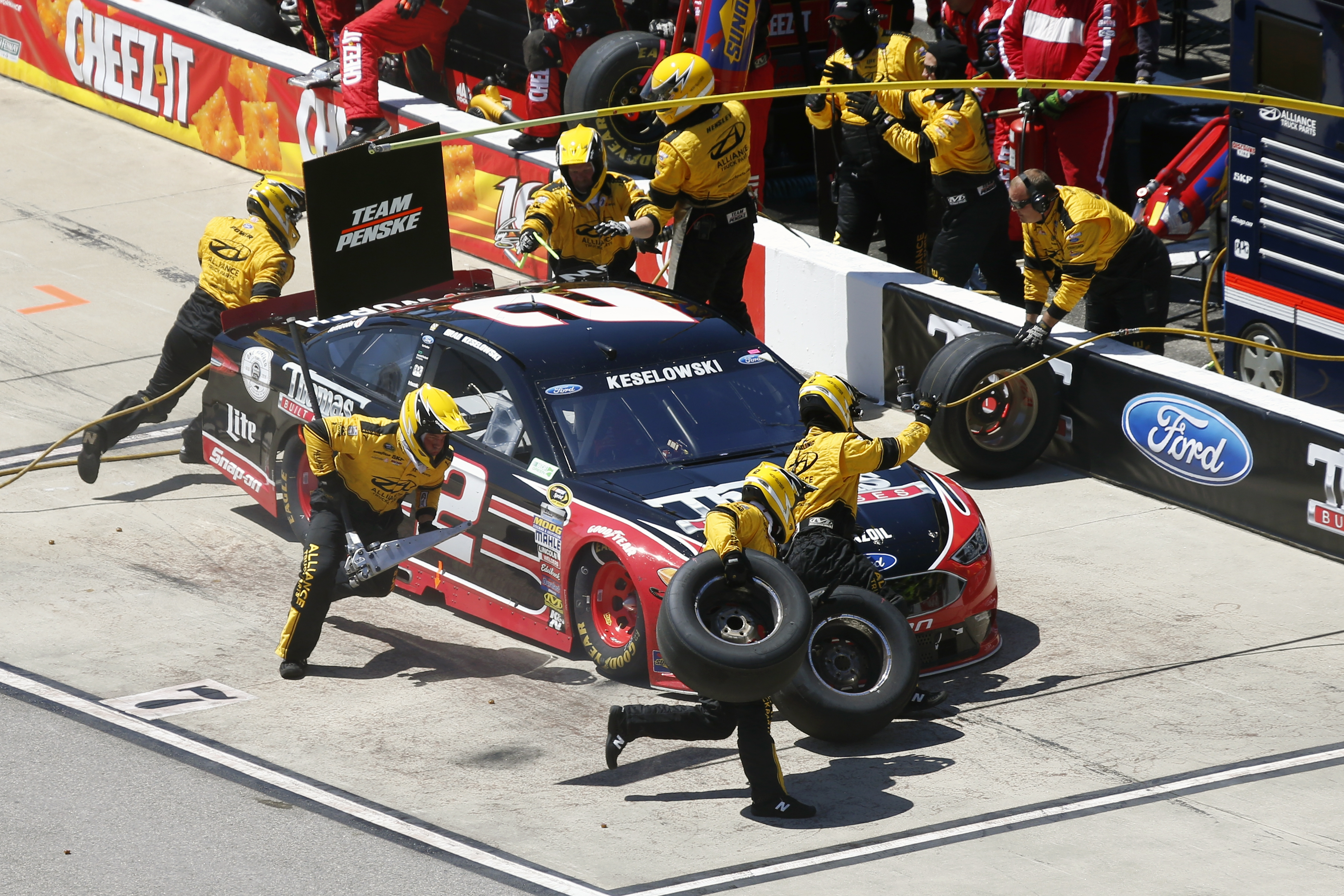 Brad Keselowski comes in for a pit stop during the Sprint Cup auto race at Richmond International Raceway in Richmond, Va., Sunday, April 24, 2016. (AP Photo/Chet Strange)