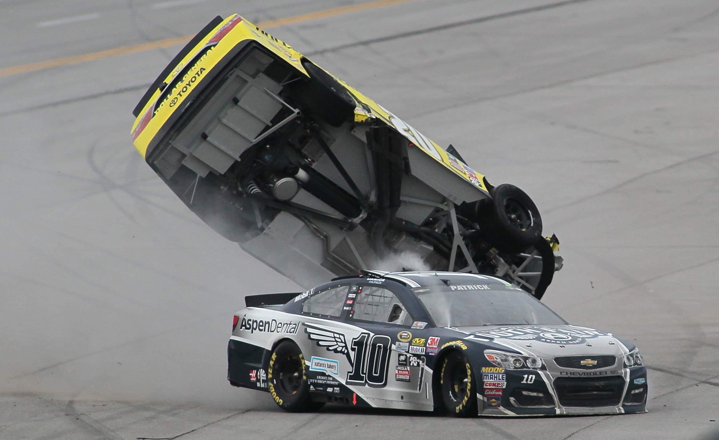 Matt Kenseth's car flips after  Danica Patrick (10) crashed into him during the NASCAR Talladega auto race at Talladega Superspeedway, Sunday, May 1, 2016, in Talladega, Ala. (AP Photo/Greg McWilliams)